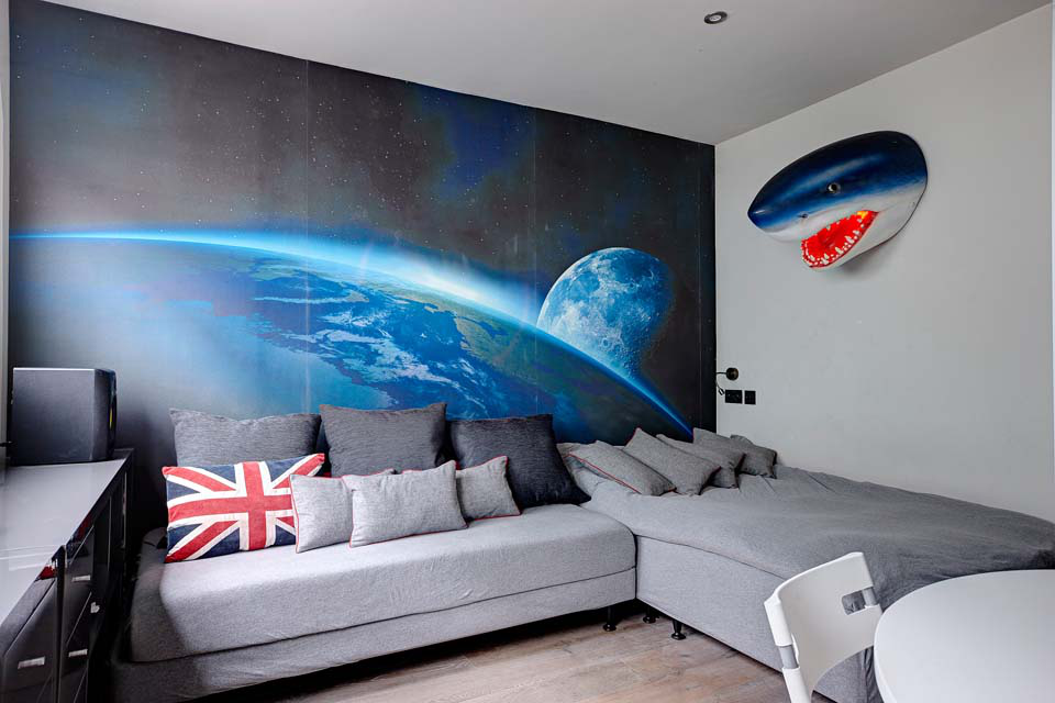 The boy's bedroom has a universe wall mural that was custom printed to fit.