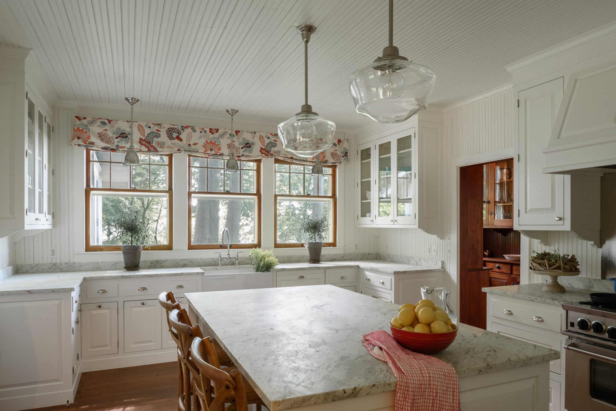 Lake Michigan cottage: renovated kitchen and original butler's pantry. By Buccellato Design, LLC