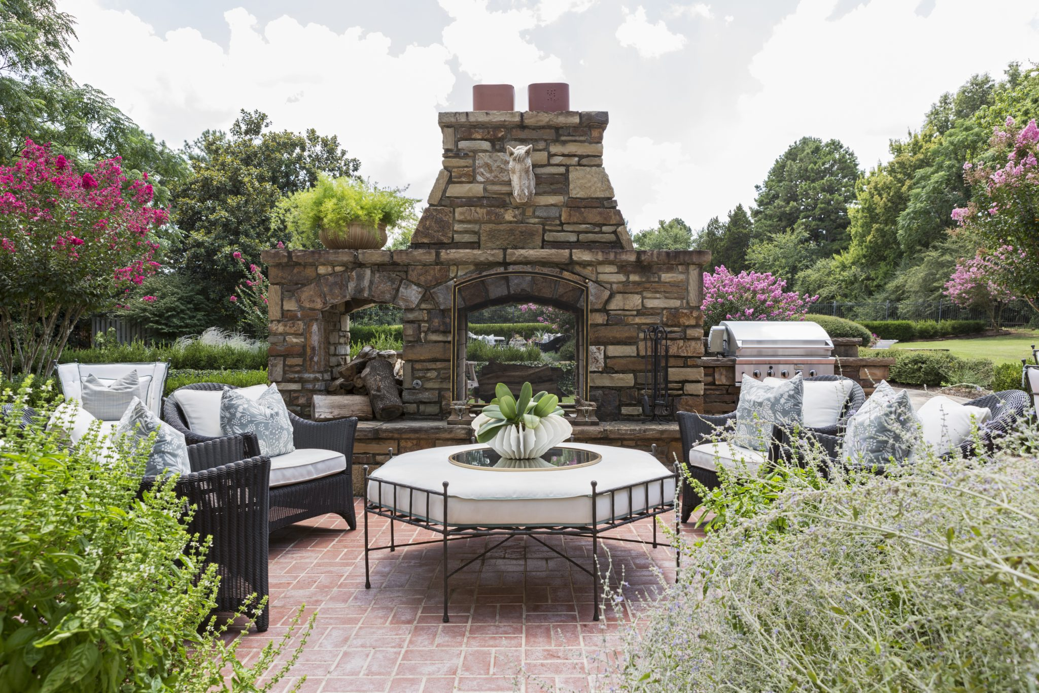 Outdoor fireplace area by Goddard Design Group
