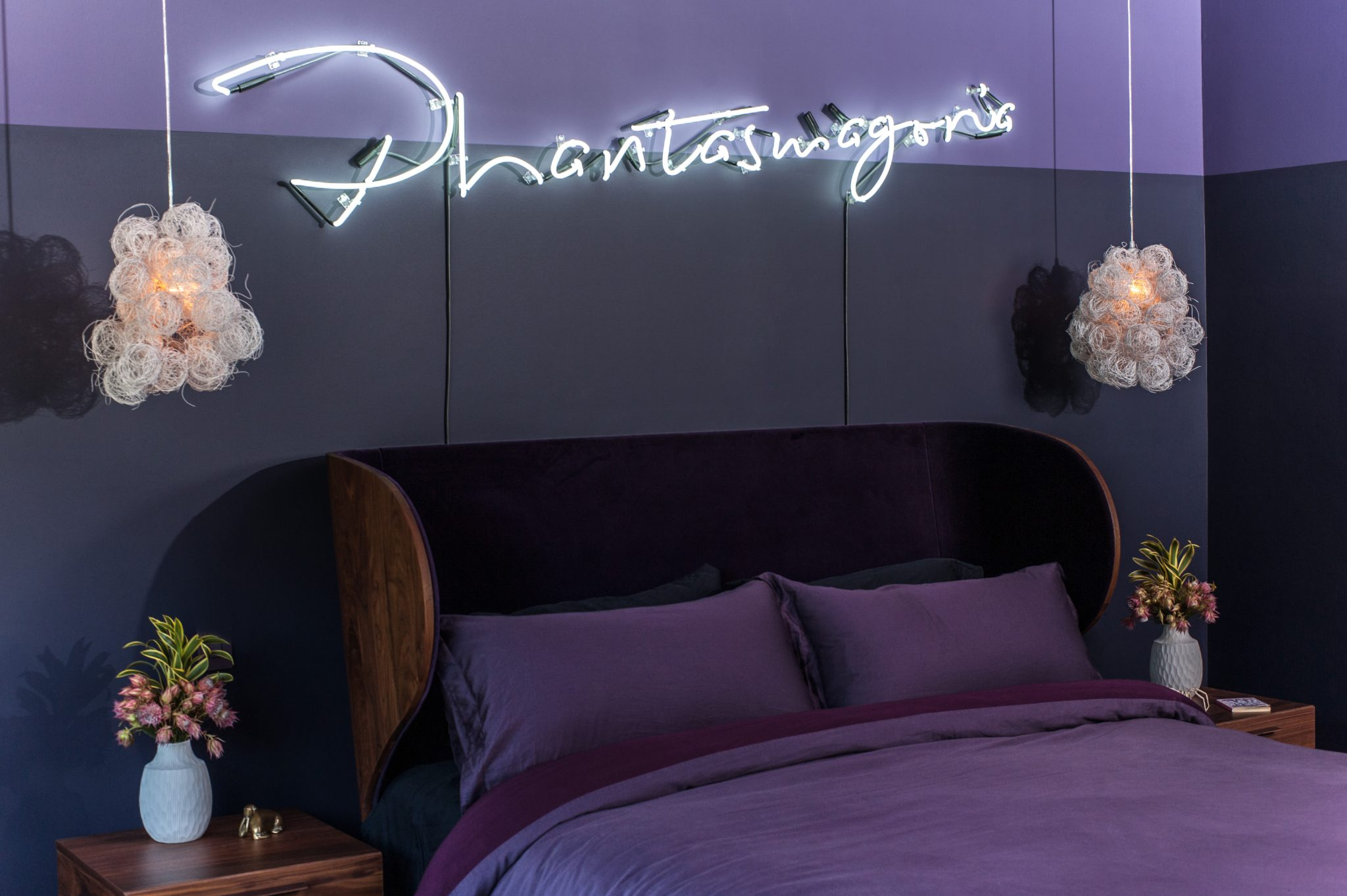 "Custom neon artwork reading ""phantasmagoria"" adds an ethereal glow. by Sarah Barnard Design"