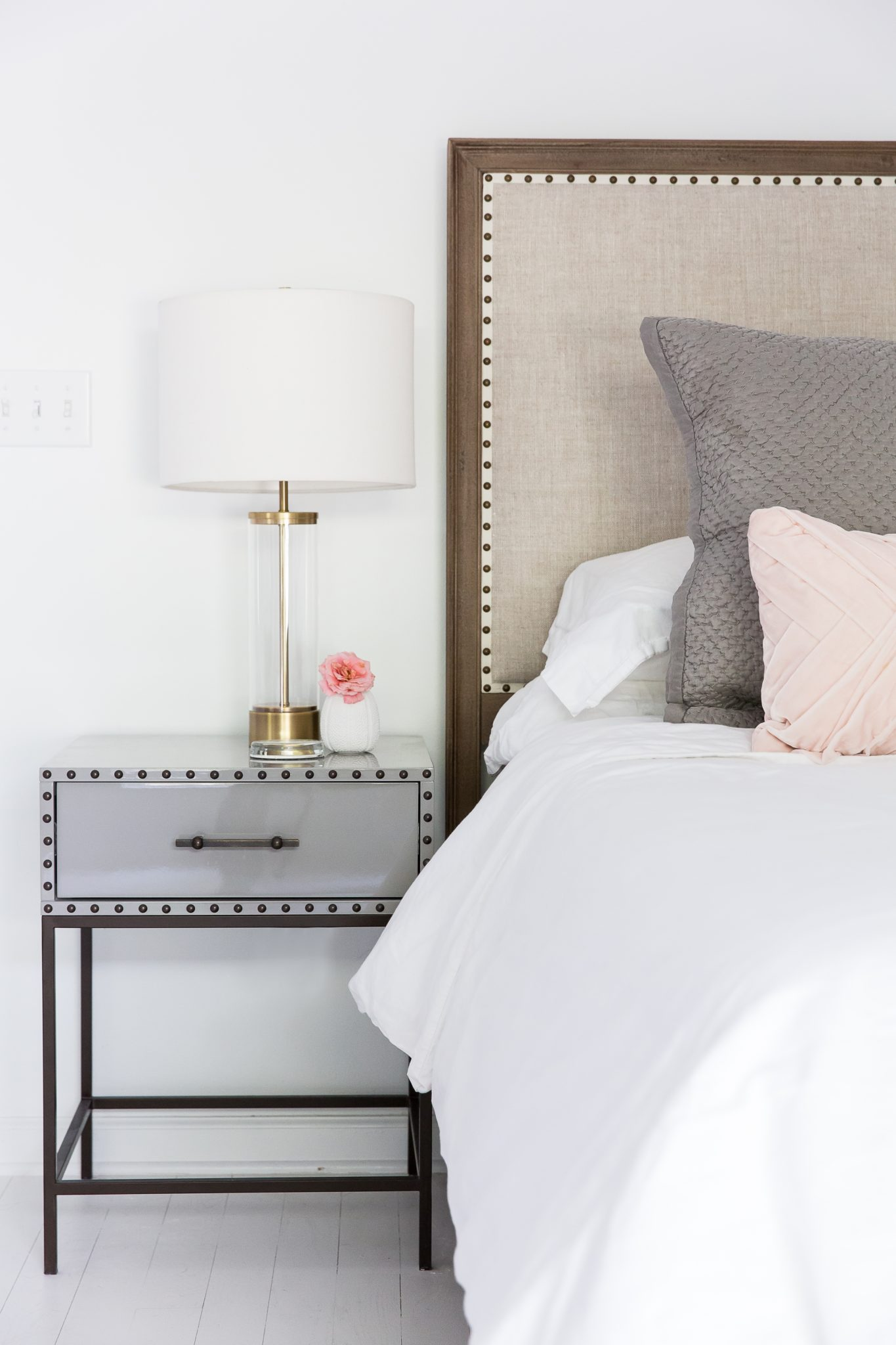 Bed in an All White Bedroom by Maureen Stevens Design