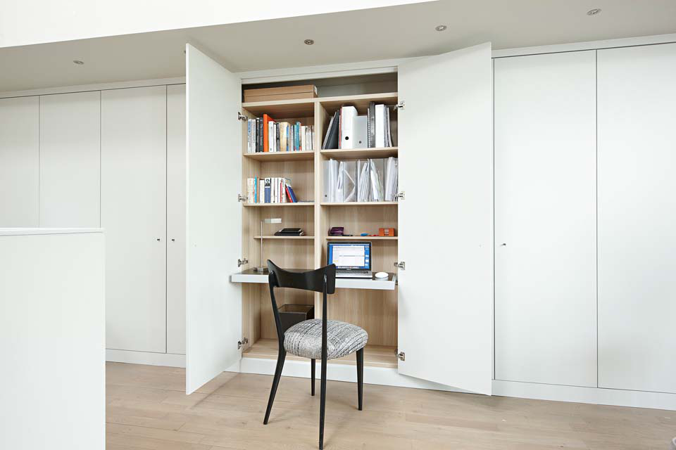 The home office is concealed within custom made storage.