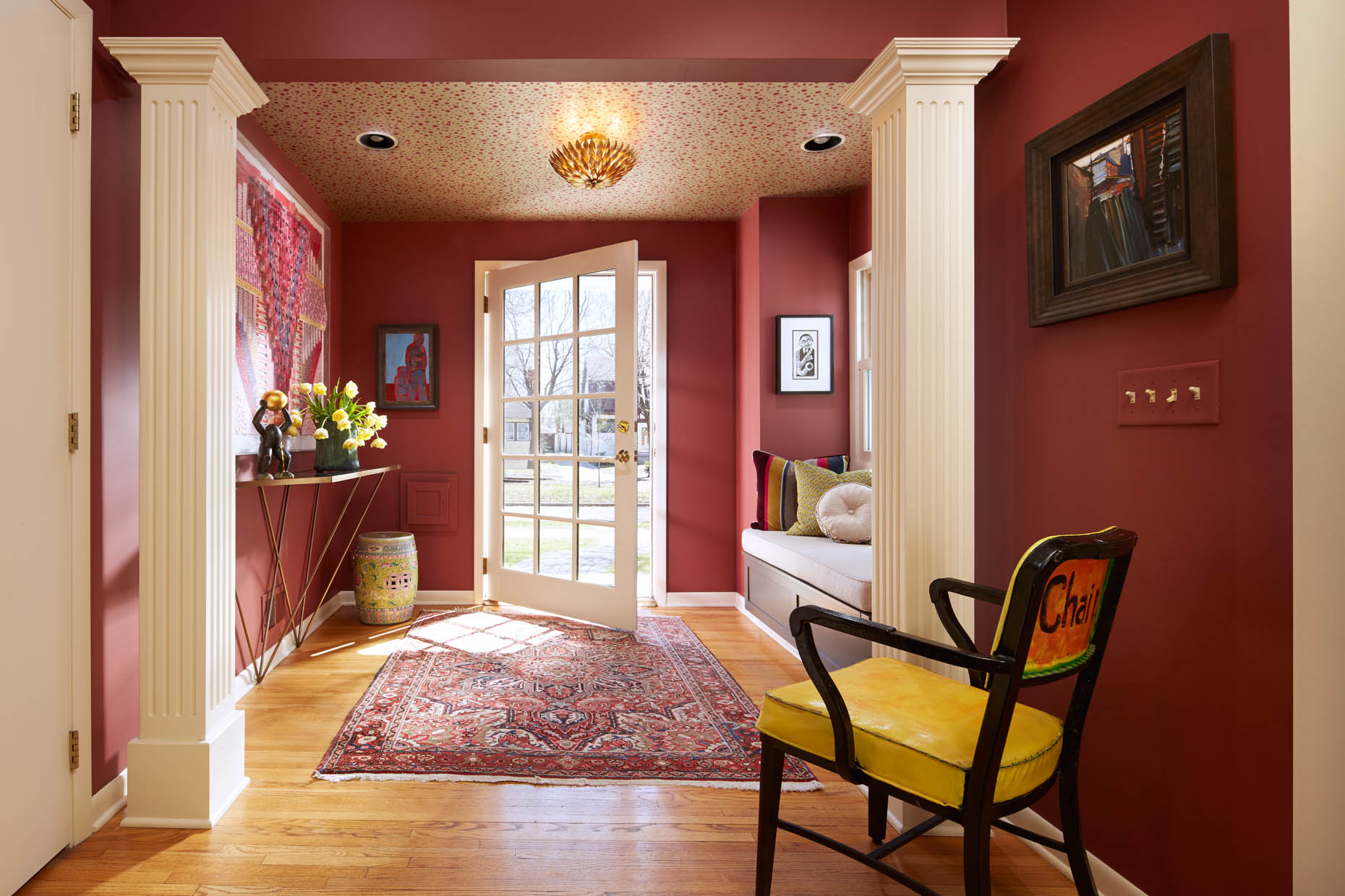 Welcoming warm foyer with an artful and whimsical twist by Susan E. Brown Interior Design