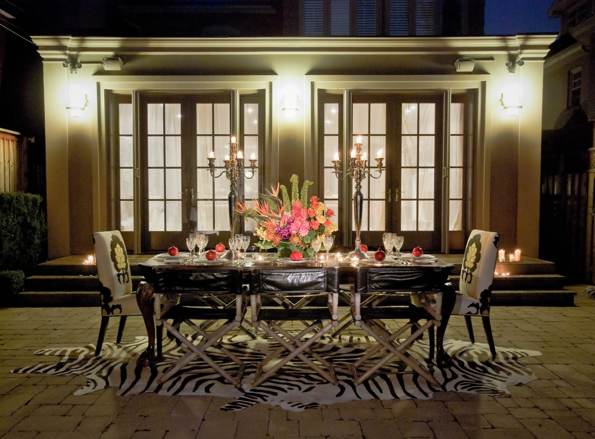 Glamourous Outdoor Dining Room by Lucid Interior Design Inc.