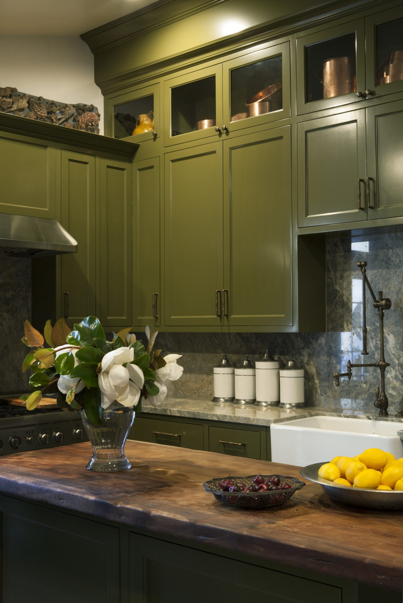 Windowless kitchen with olive green cabinetry by Blythe Home