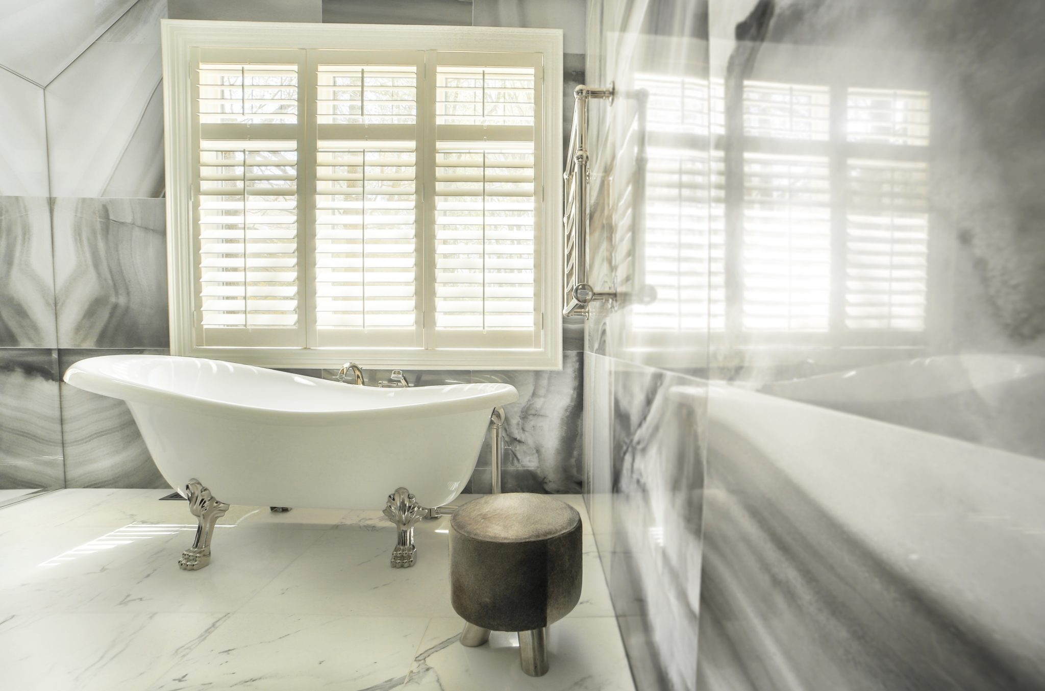 Exquisite materials in sophisticated master ensuite bathroom by Lucid Interior Design Inc.