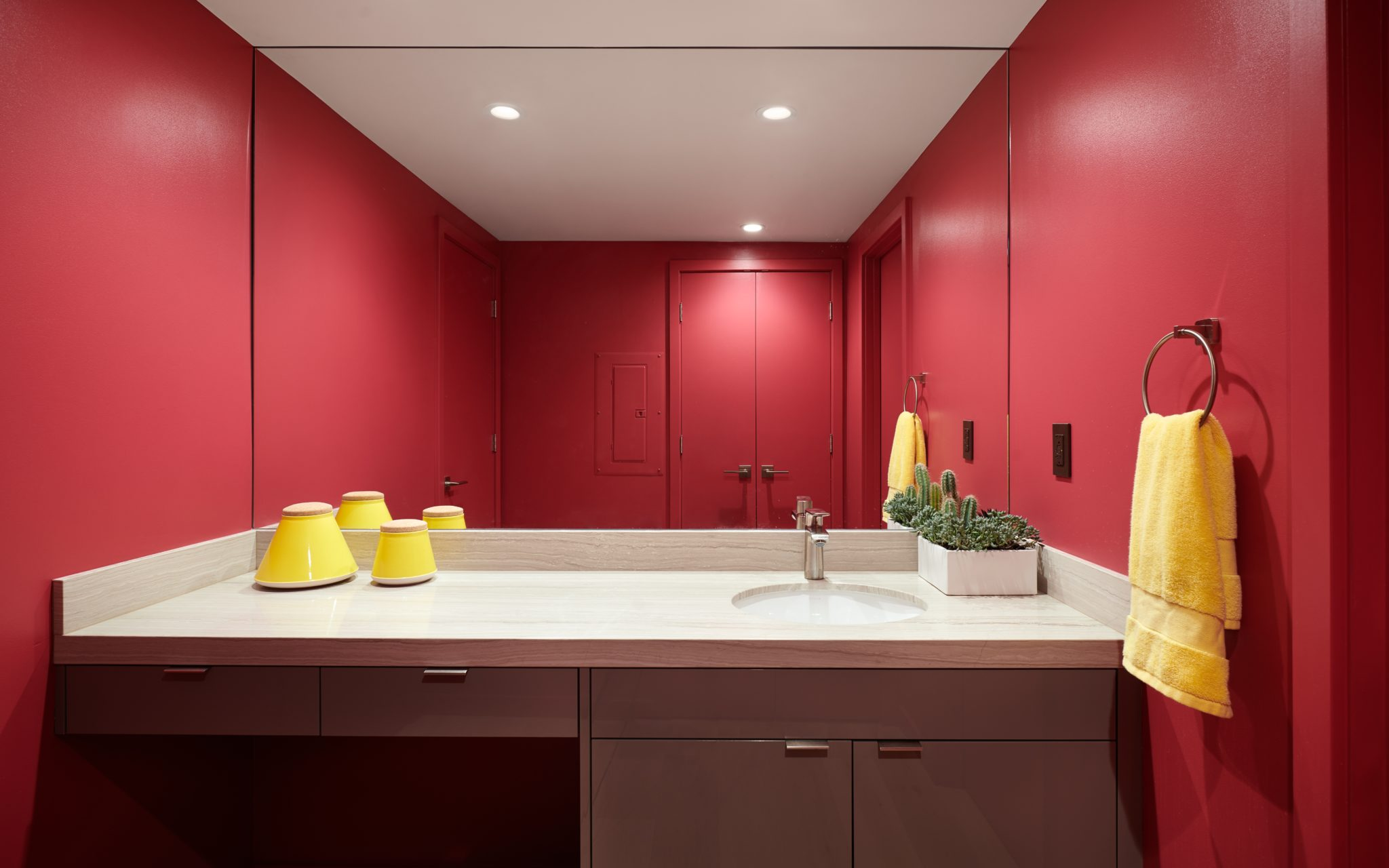 For the powder room, Mallon was inspired by saturated bathrooms of the San Francisco Museum of Modern Art (SFMOMA). The hue is Aniline Red fromBenjamin Moore & Co.