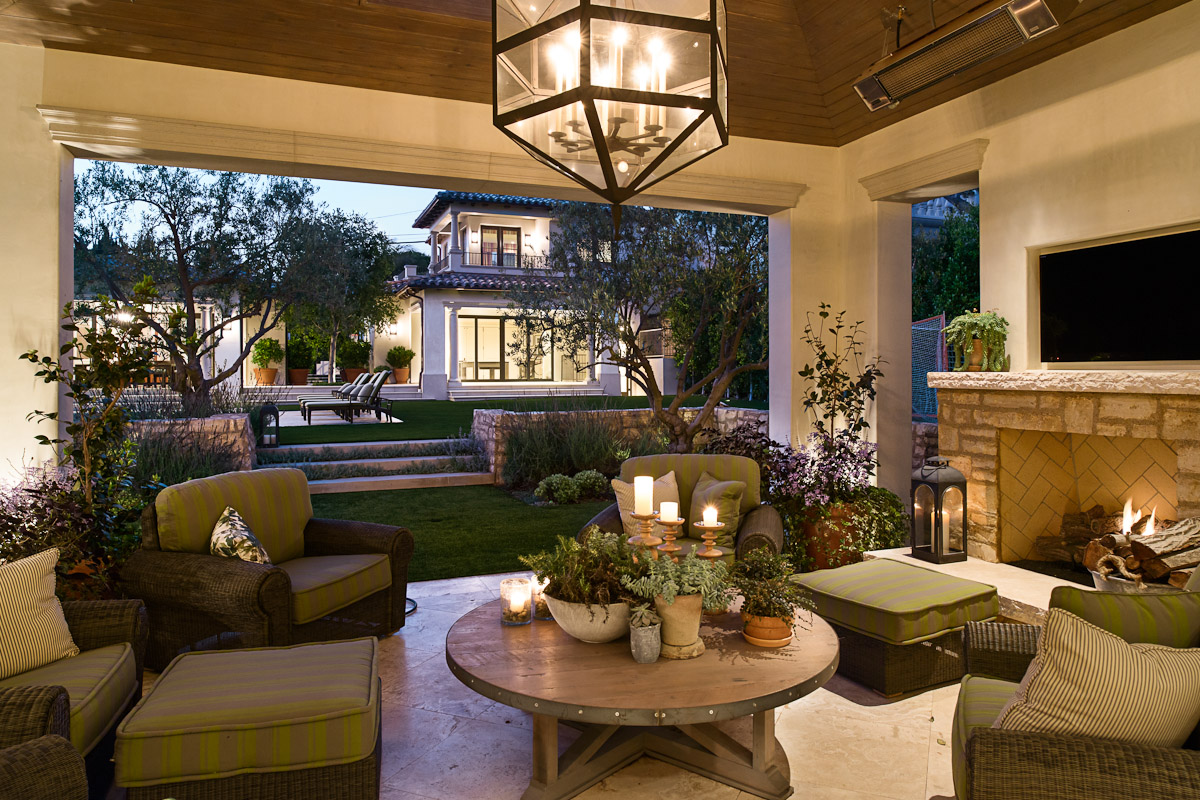 Outdoor living room is an extension of the adjacent great room. Brown Jordon lounge chairs, reclaimed cocktail table and Paul Ferrante lantern by Kevin Corn Design