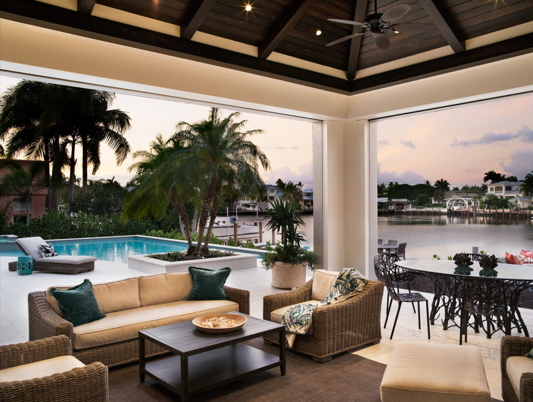 Outdoor lanai dining area and living space by Judith Liegeois Designs