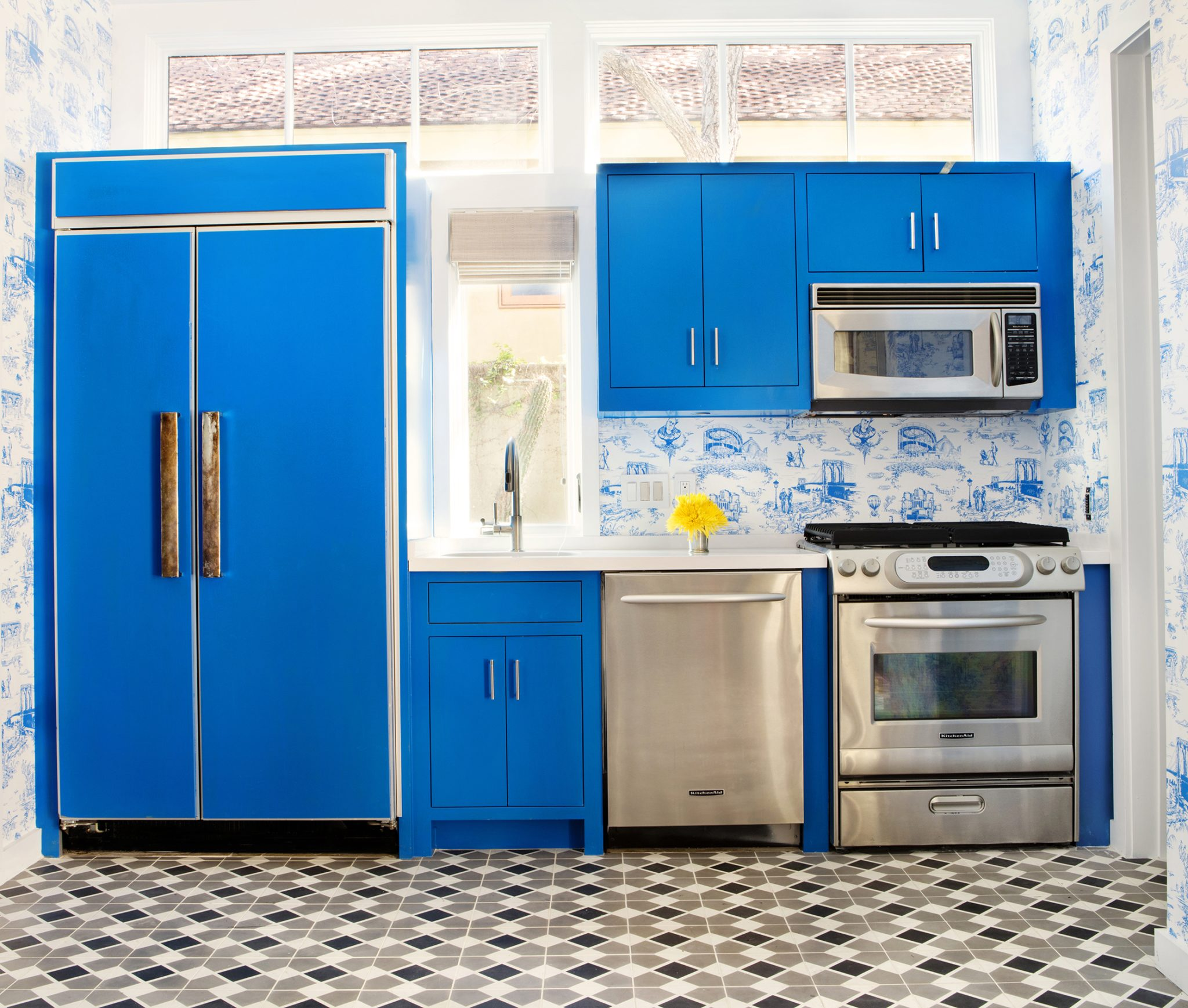 Pool house kitchen with blue gloss cabinetry, cement tile and toile wallpaper by Sarah Wittenbraker Interiors