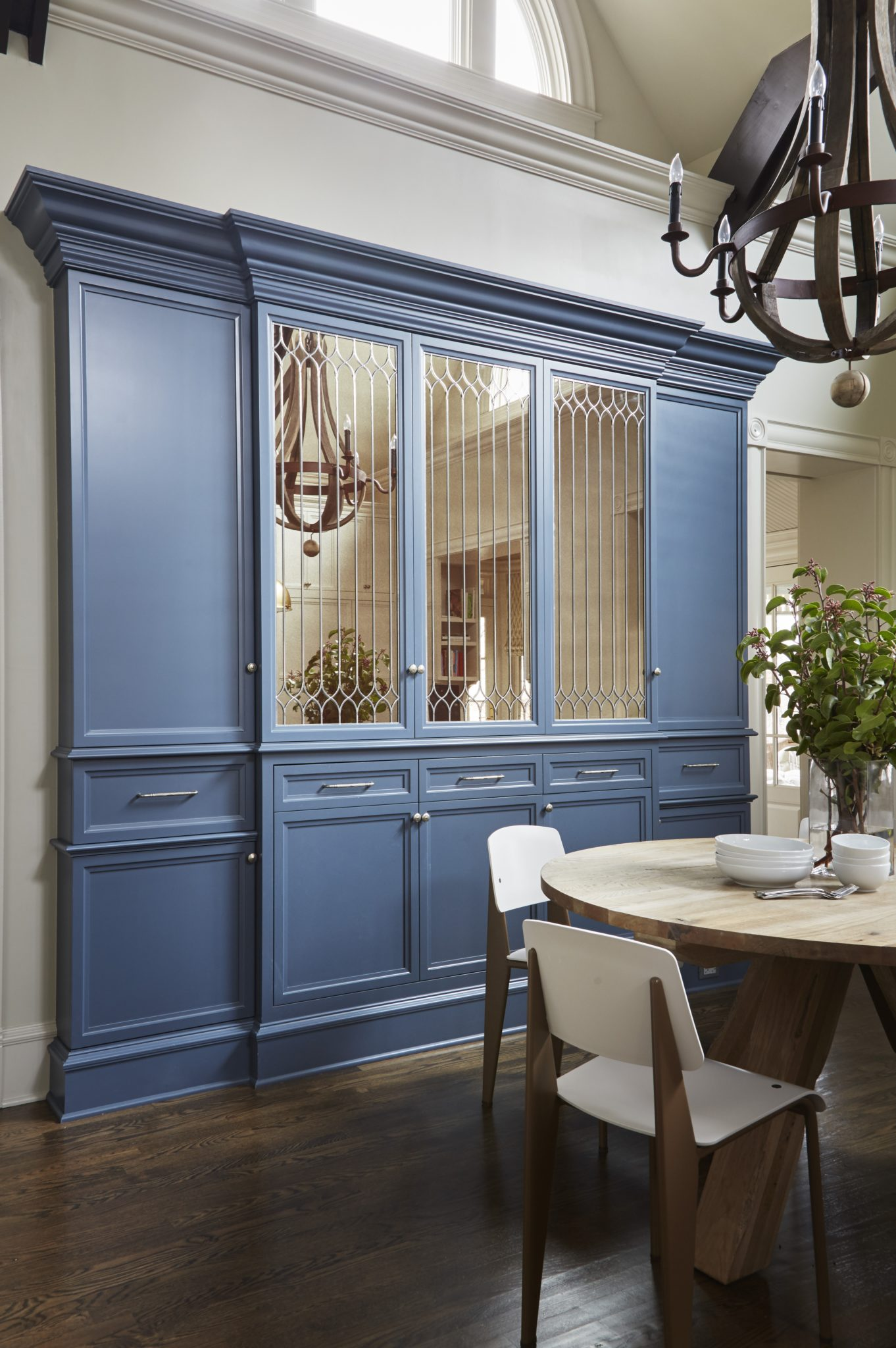 Kitchen with barrel wood chandelier and blue cabinets by 2to5 Design