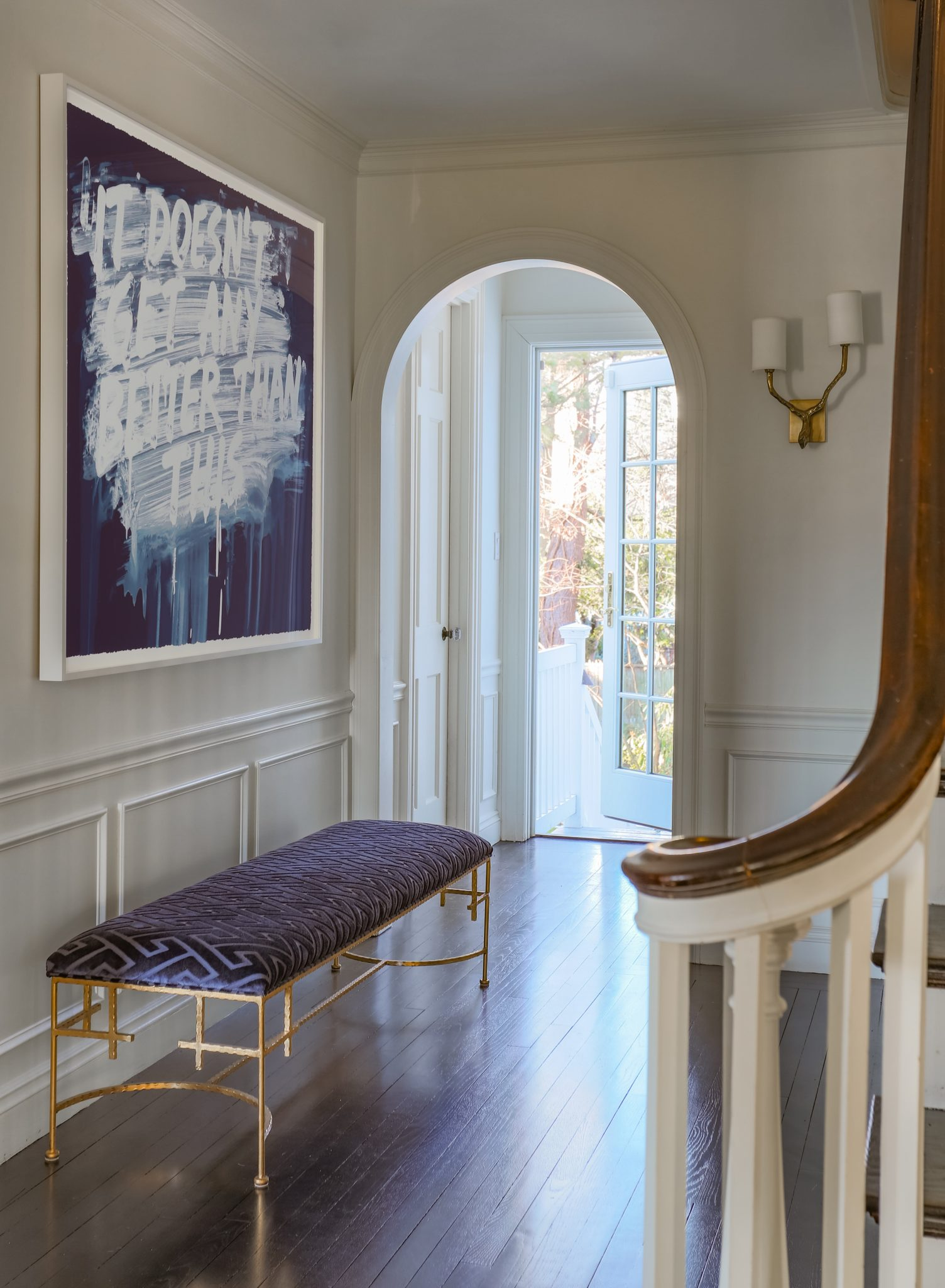 Modern Entry with Contemporary Art and Gold Leaf Bench by Kristin Paton Interiors
