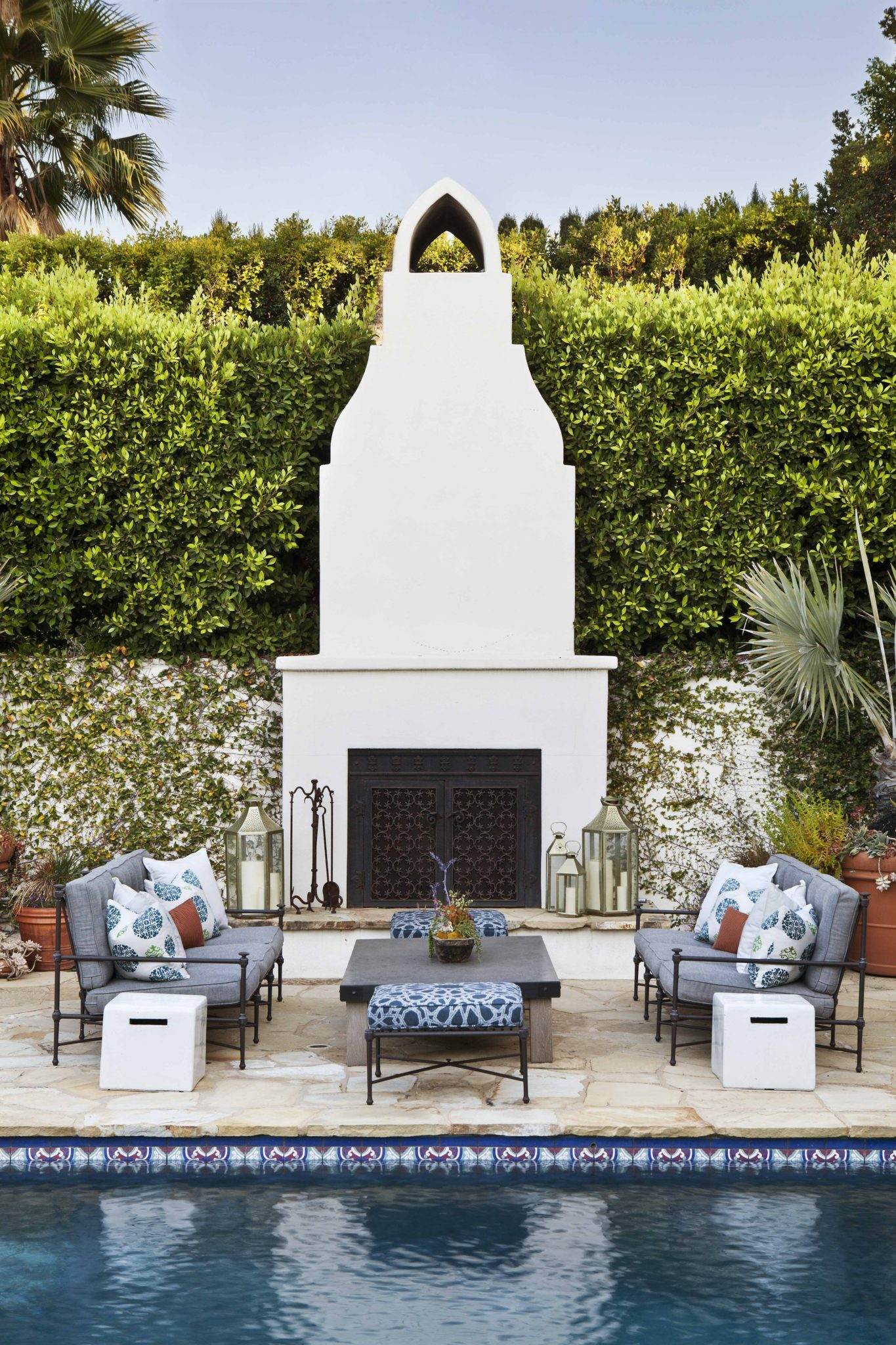 Outdoor Plaster Fireplace by Brown Design Group