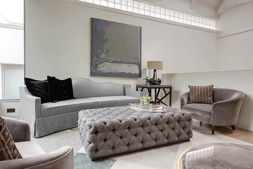 All furniture in this upper floor seating area is from the Michael Reeves M. R. Collection. The Cadogan sofa is upholstered in Zimmer & Rhodes fabric and the deep buttoned Hanover ottoman is covered in Nya Nordiska quilted cotton. The painting is by Diane Carl, a Dallas artist.