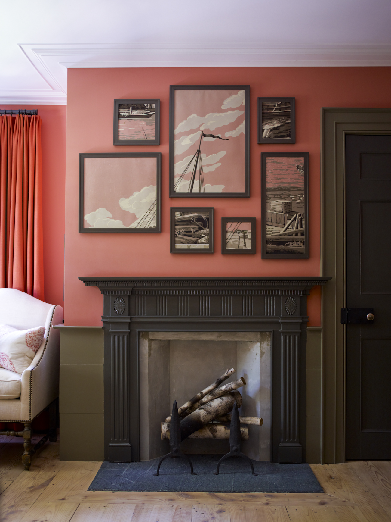 """""""The pink bedroom, inspired by a room we had decorated in our previous house, contains the same color combination. The painted framed fragments were once a 19th-century folding screen. I cut it up and kept only the parts that fit my nautical theme."""""""