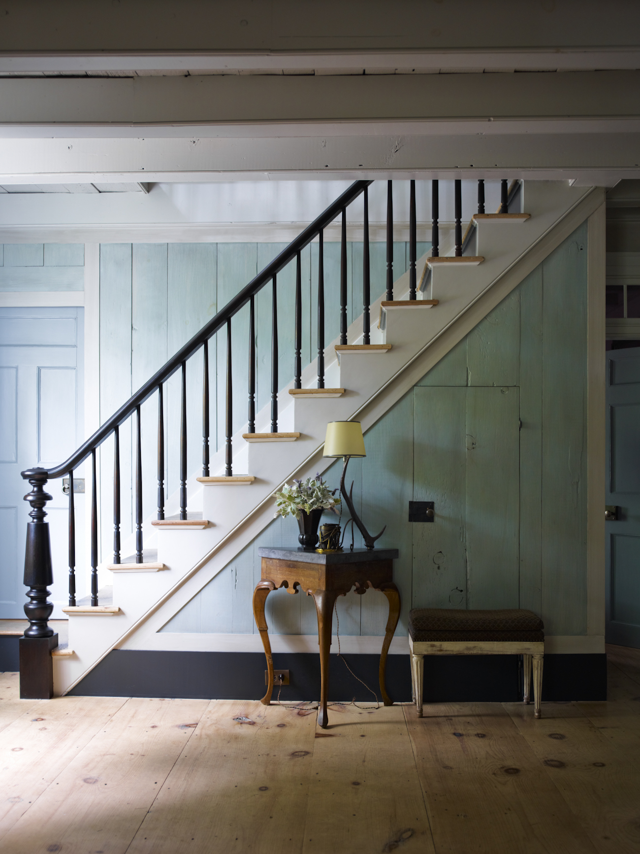 """""""The main staircase was preserved, but the original railing had been removed years before. We found this one at a local tag sale in Sag Harbor and used the parts to replicate what would have been in a house such as this."""""""
