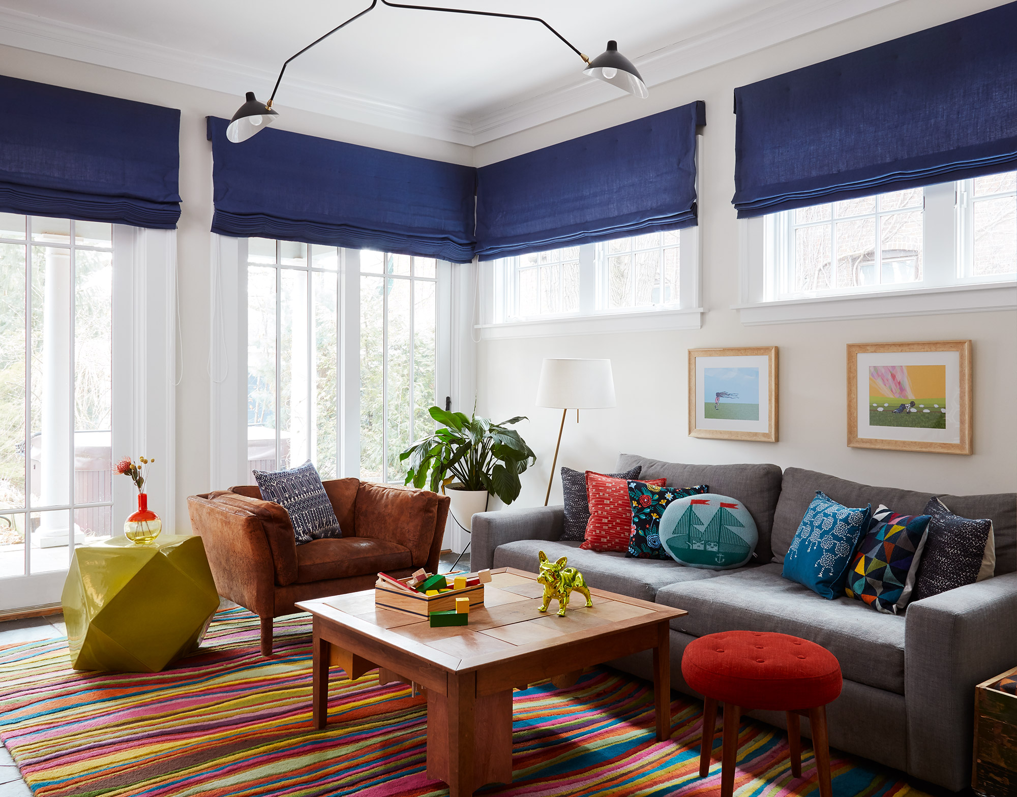 Evanston family room with brightly colored rug and Serge Mouille light by 2to5 Design