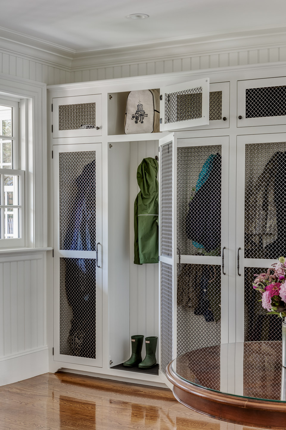 Mudroom featuring Chicken Wire Doors by Patrick Ahearn Architect