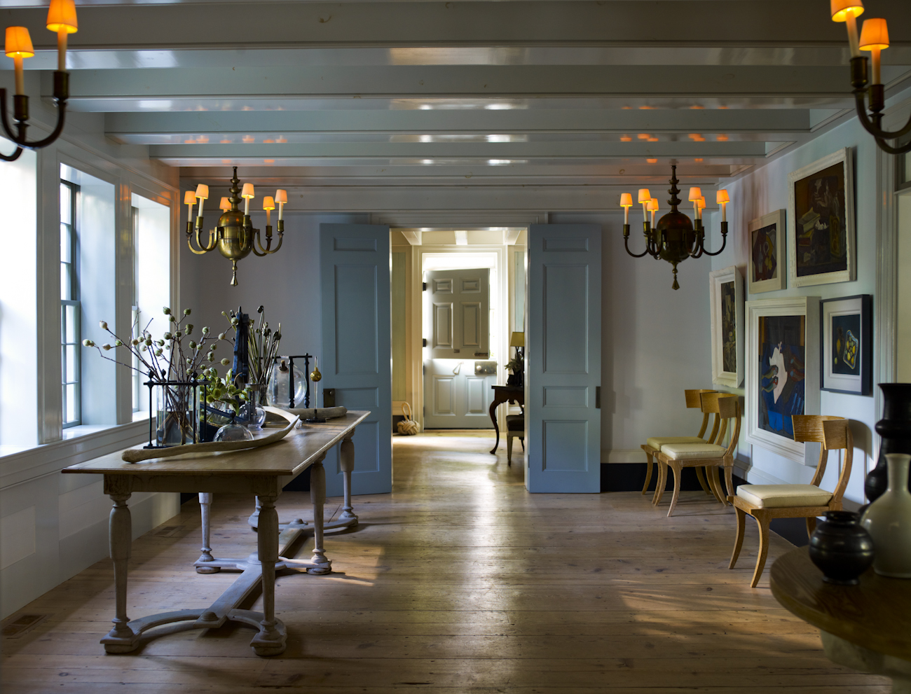 """""""The open central hallway is transformed into a dining area for larger dinner parties."""""""