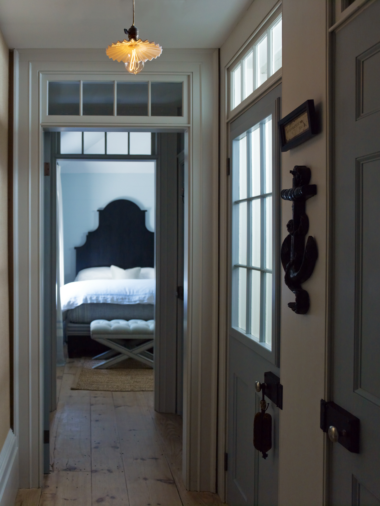 """""""The guest bedroom halls have several transoms, where light filters through the spaces, providing illumination onto vignettes and curiosities."""""""