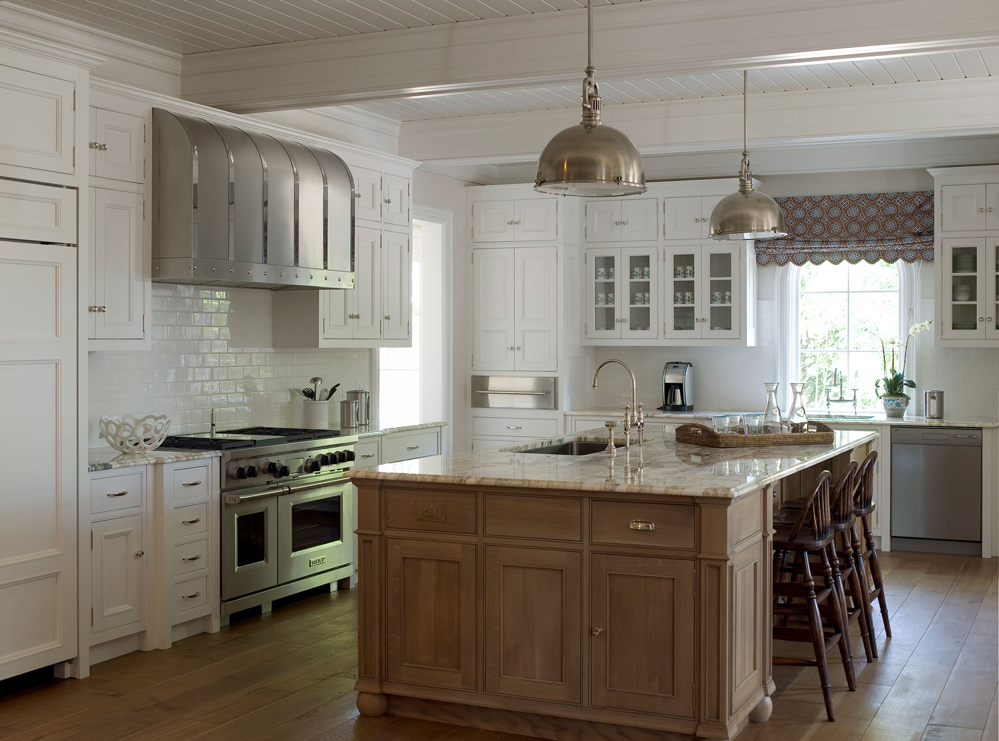Sea Island, Georgia, kitchen with large island and customer hood. By James Michael Howard