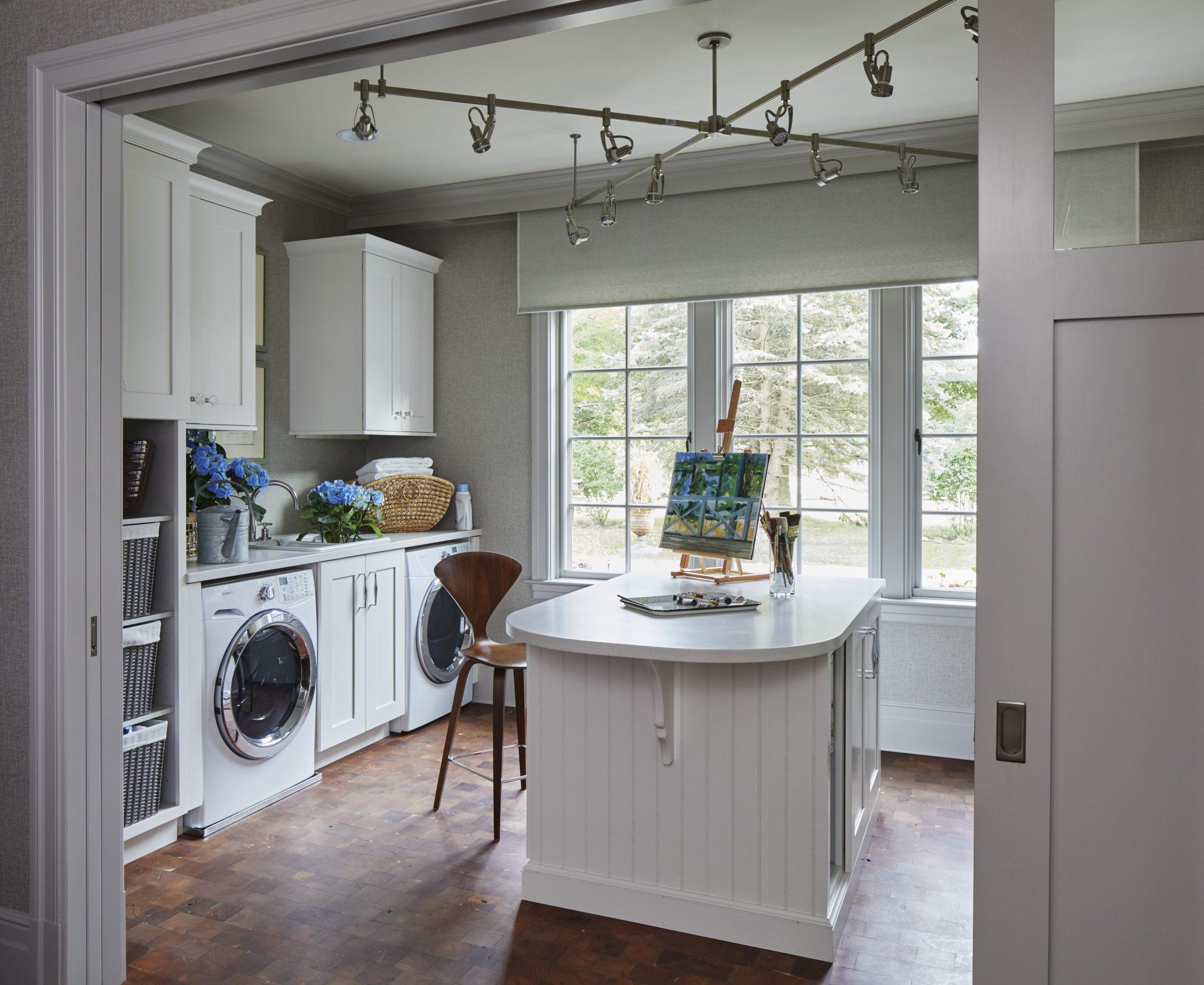 Wood and white Art & Laundry Studio, walnut Cherner stool, waxed mesquite floor by Elizabeth Drake