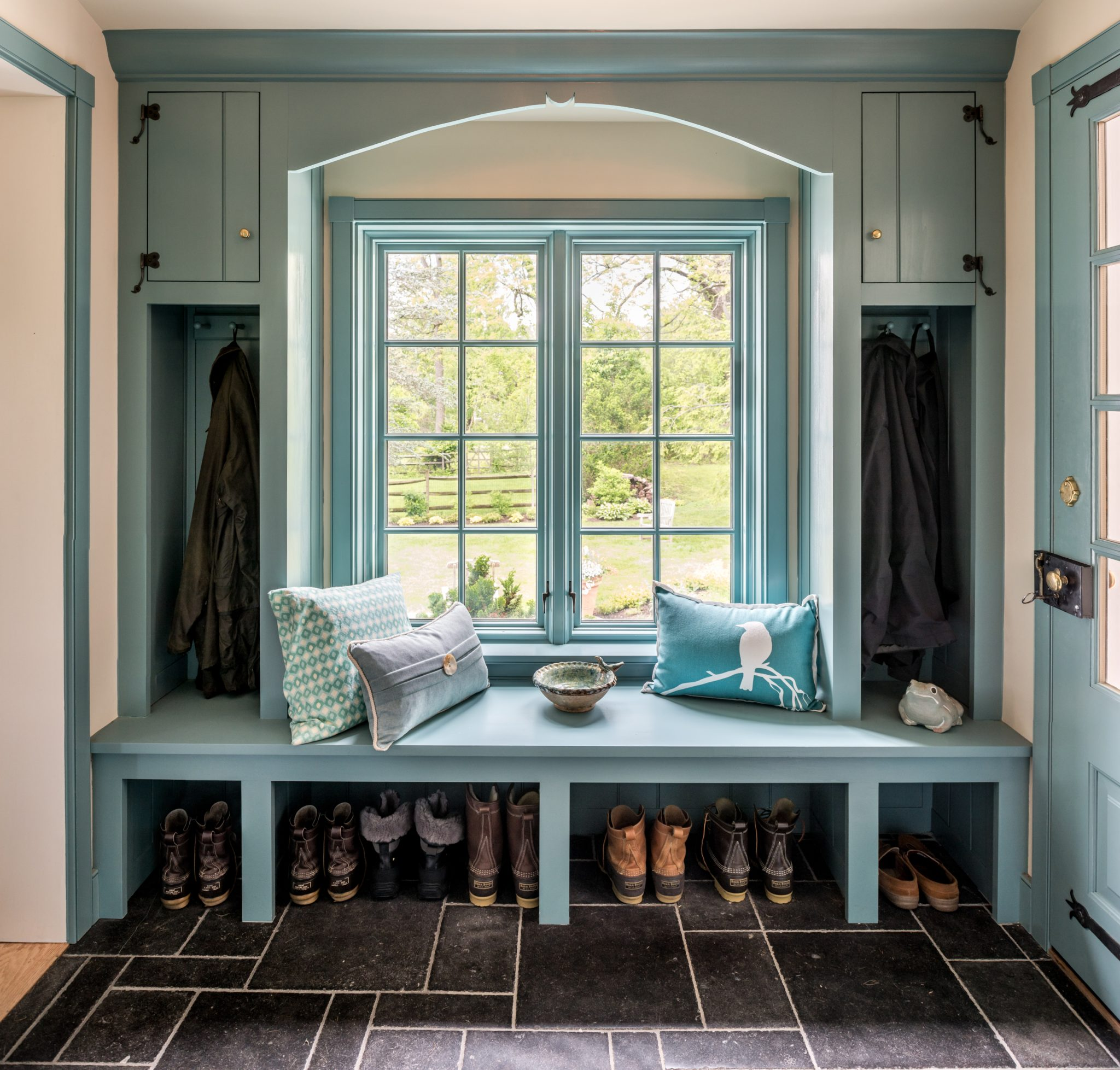 Blue mudroom addition with farmhouse details in Berwyn, Pennsylvania by Period Architecture