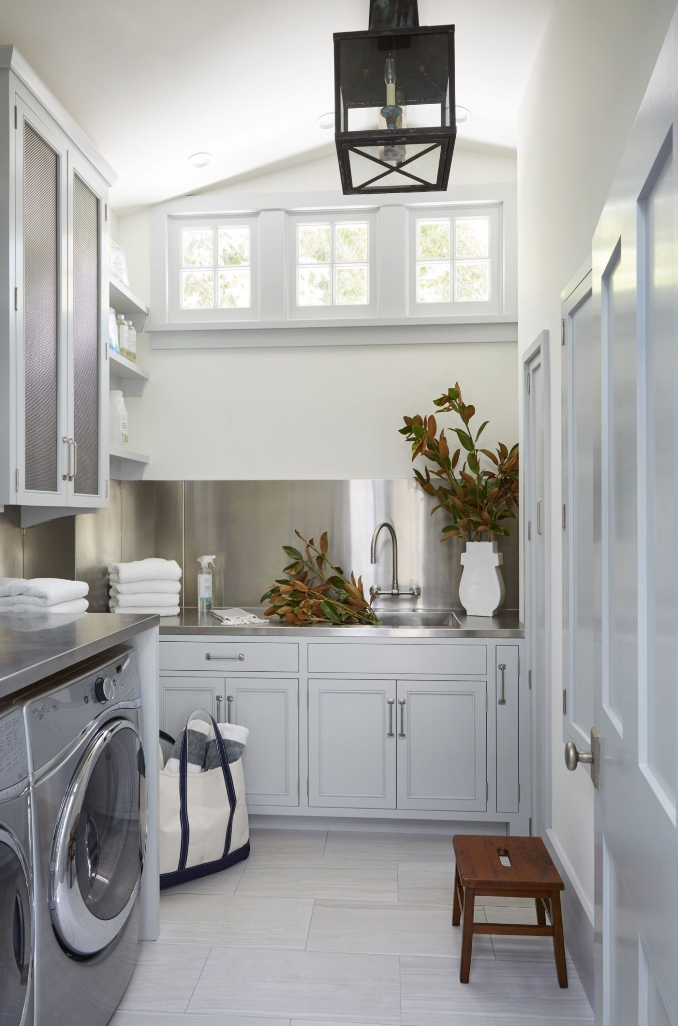 Laundry Room in a Ranch House Renovation by Tim Barber Ltd.