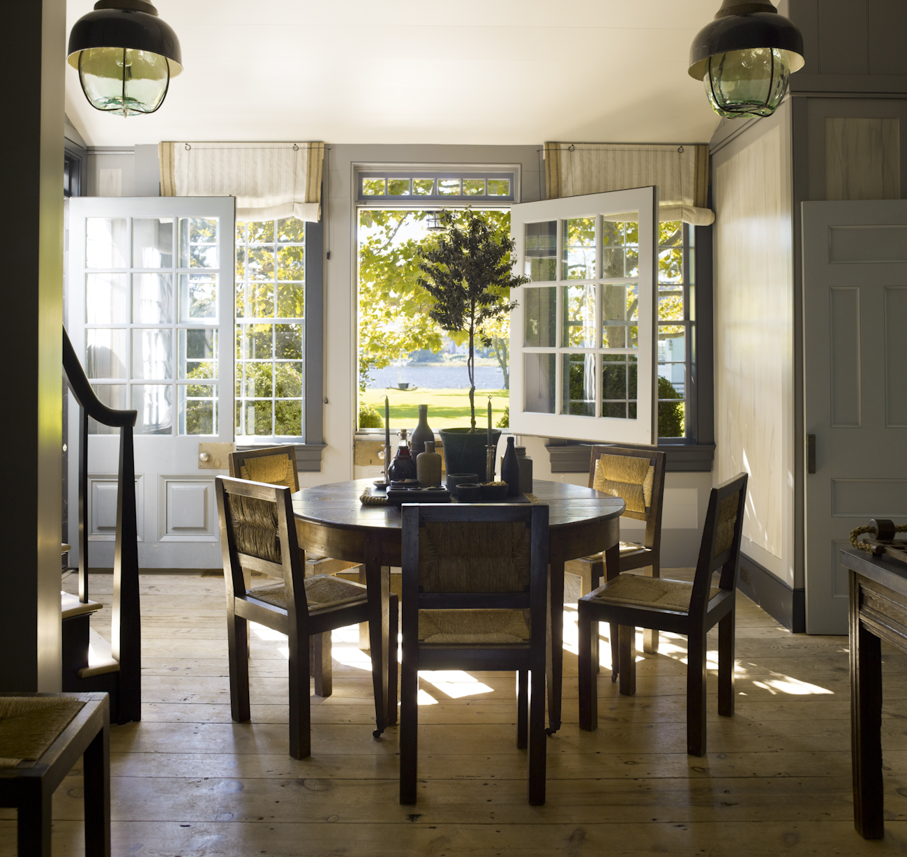 """""""A breakfast area off the kitchen is the perfect place for coffee and the paper first thing in the morning. The Dutch doors bring the outdoors inside and a private stair to the Master Bedroom provides an ultimate convenience."""""""