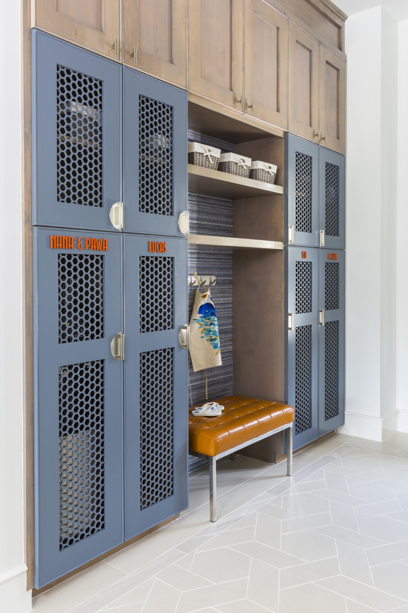 Family mudroom with customized lockers in a contemporary home design by Laura U, Inc.
