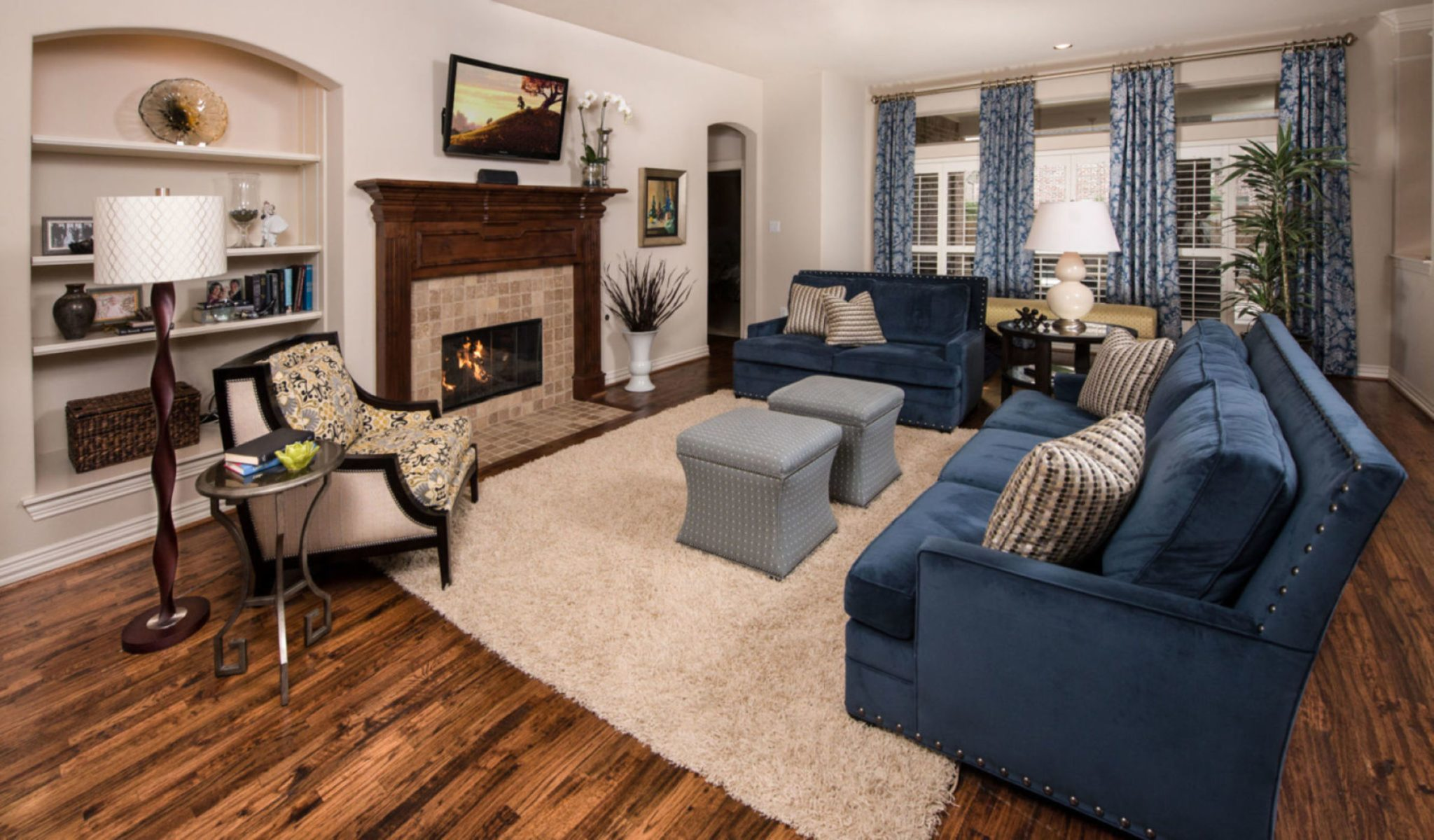 Transitional, navy living room by Nicole Arnold Interiors