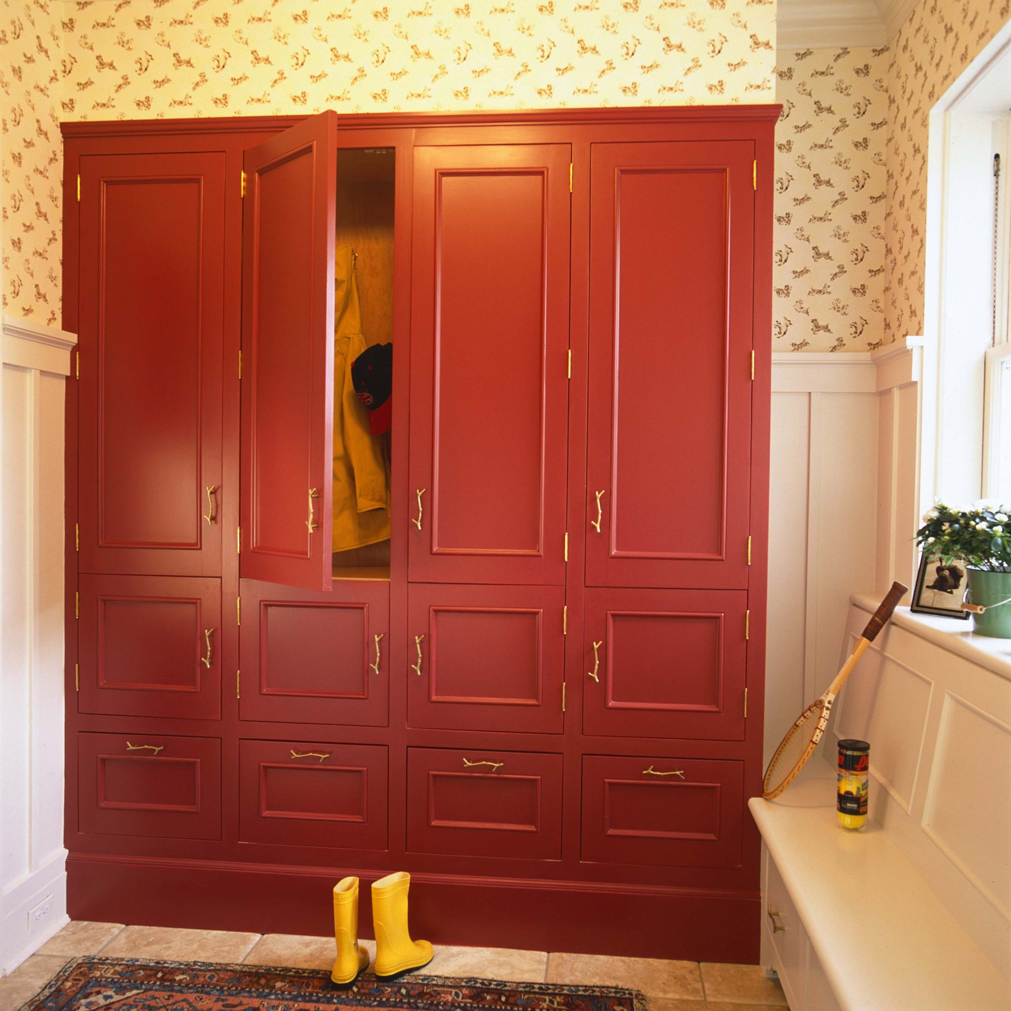 Mudroom with red cabinets by Huestis Tucker Architects, LLC