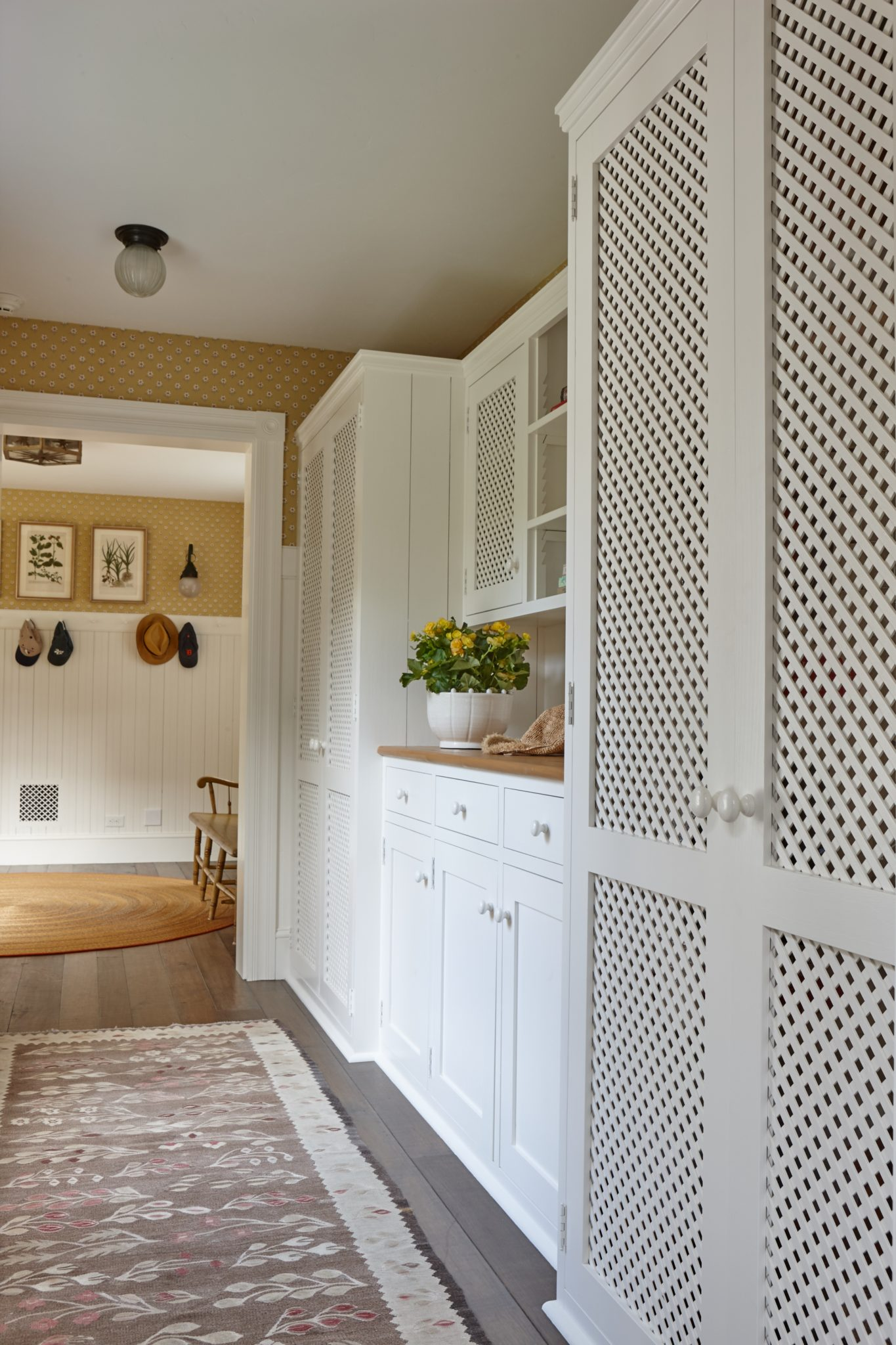Millwork leading to mudroom. by Liliane Hart Interiors
