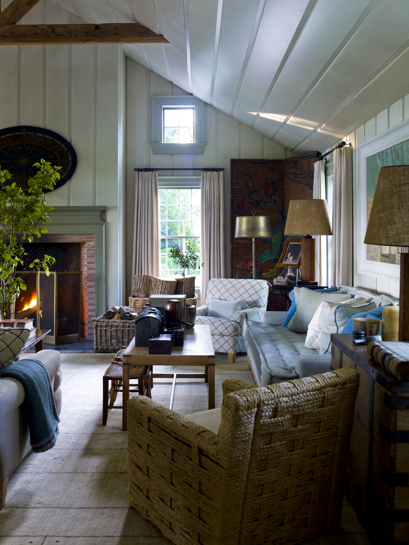 """""""The living room was built within the walls of a garage in 1964. The scale of the living room makes for an ideal entertaining space. I designed the rug to align with the wide pine floor planks, reclaimed from an 18th-century house in Maine."""""""