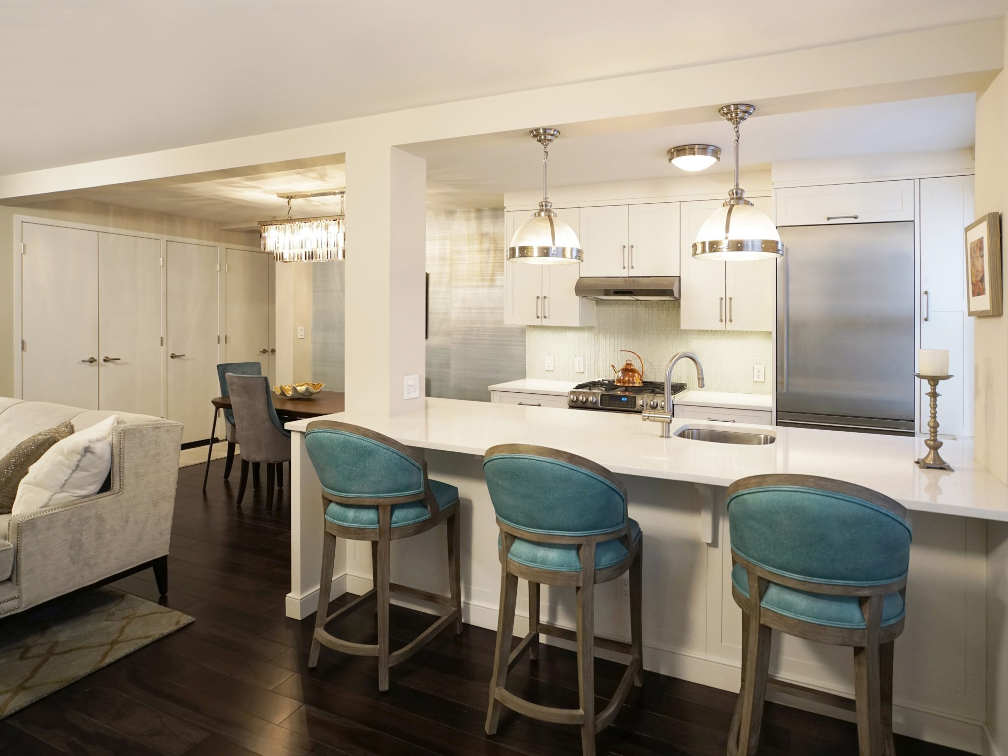 Modern glam dining area and custom island by Paula McDonald Design Build & Interiors