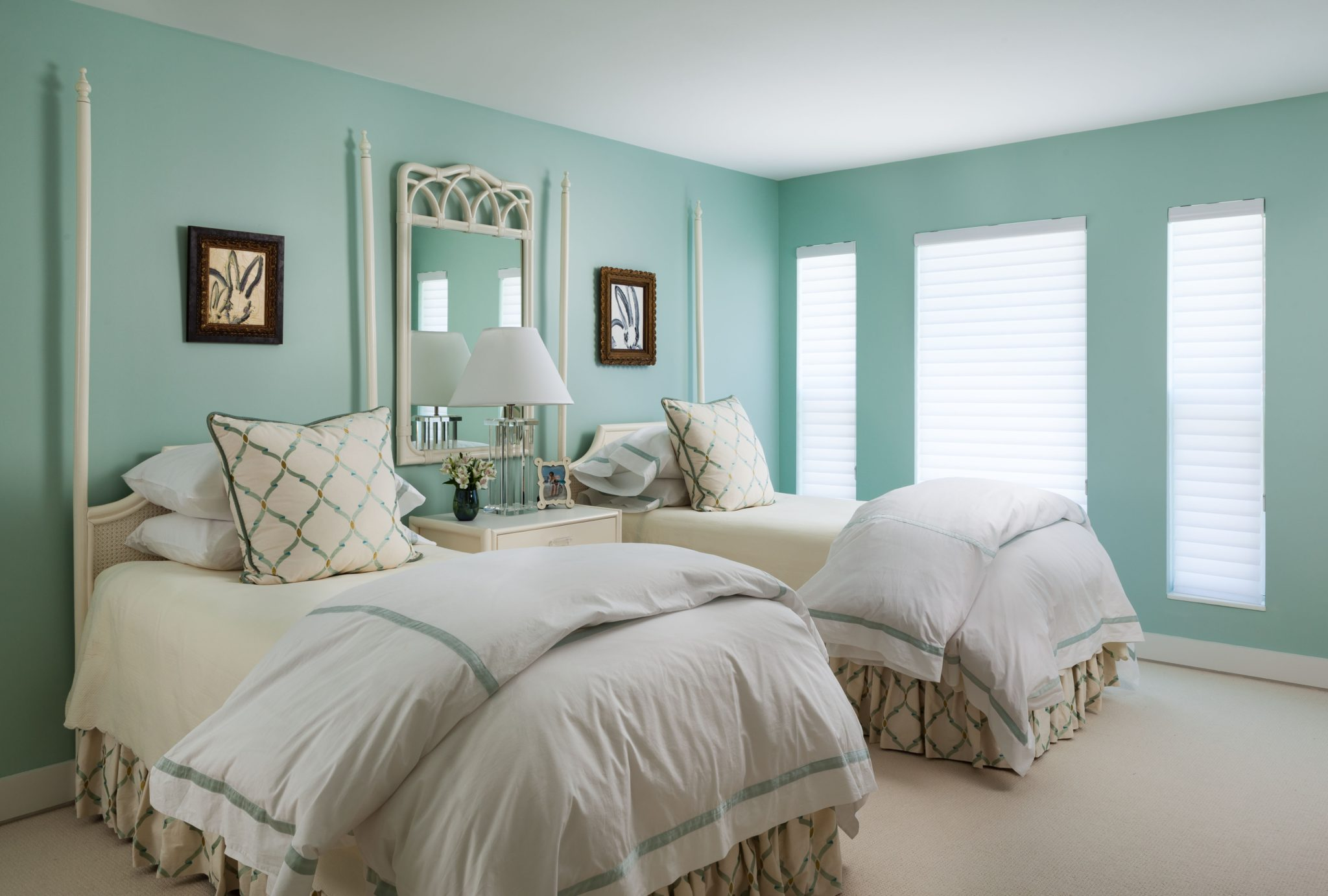 The guest bedroom is a serene retreat with Tiffany blue wall paint and light ivory case-goods. By Gil Walsh Interiors
