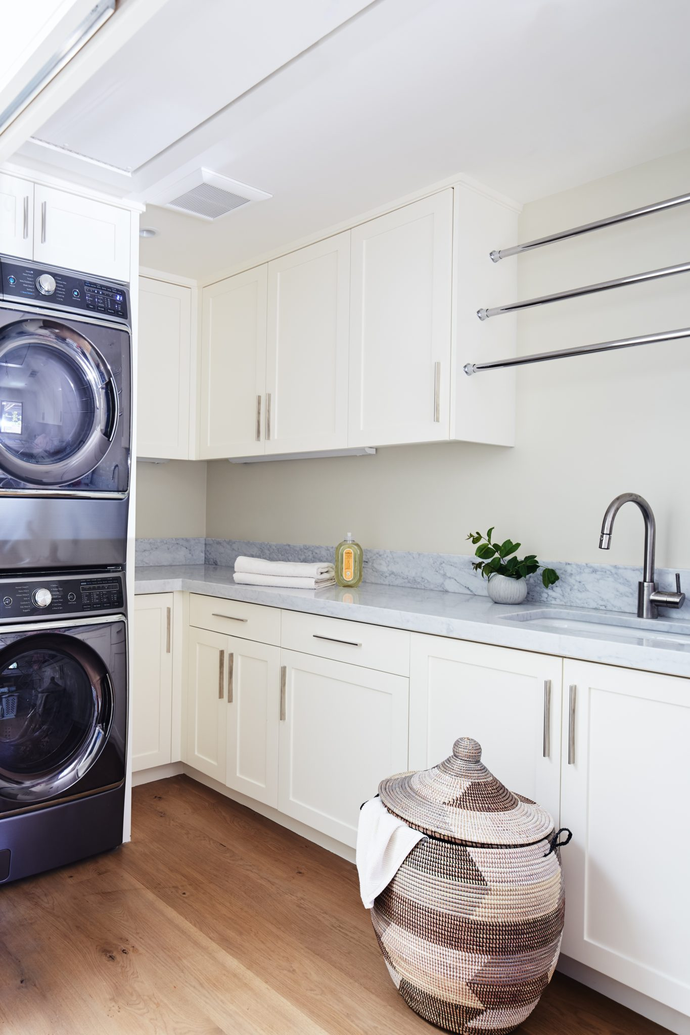Clean and White Laundry Room by Staprans Design
