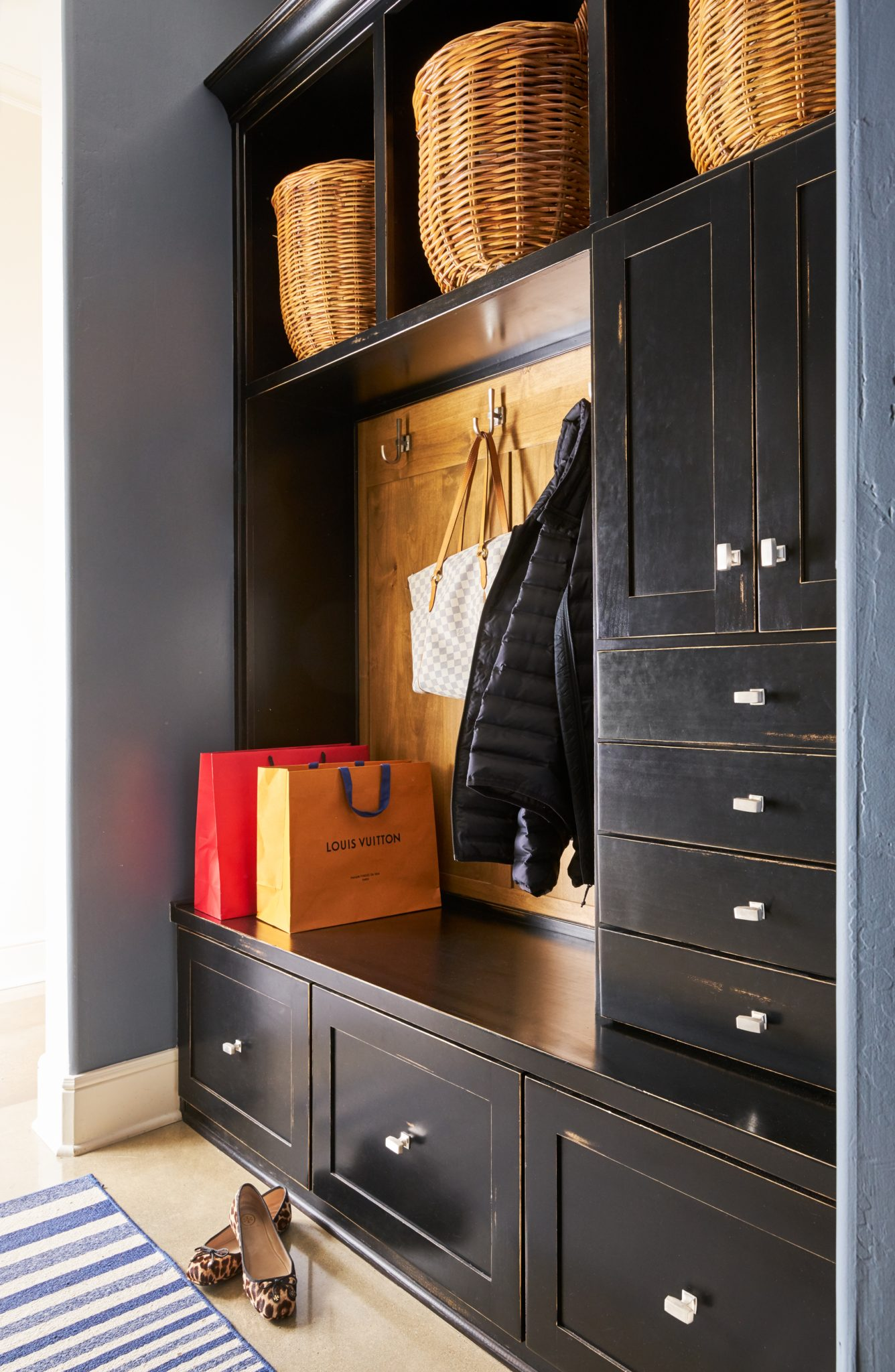 Built-in black cabinetry is a dramatic and sophisticated storage solution. by Wesley-Wayne Interiors