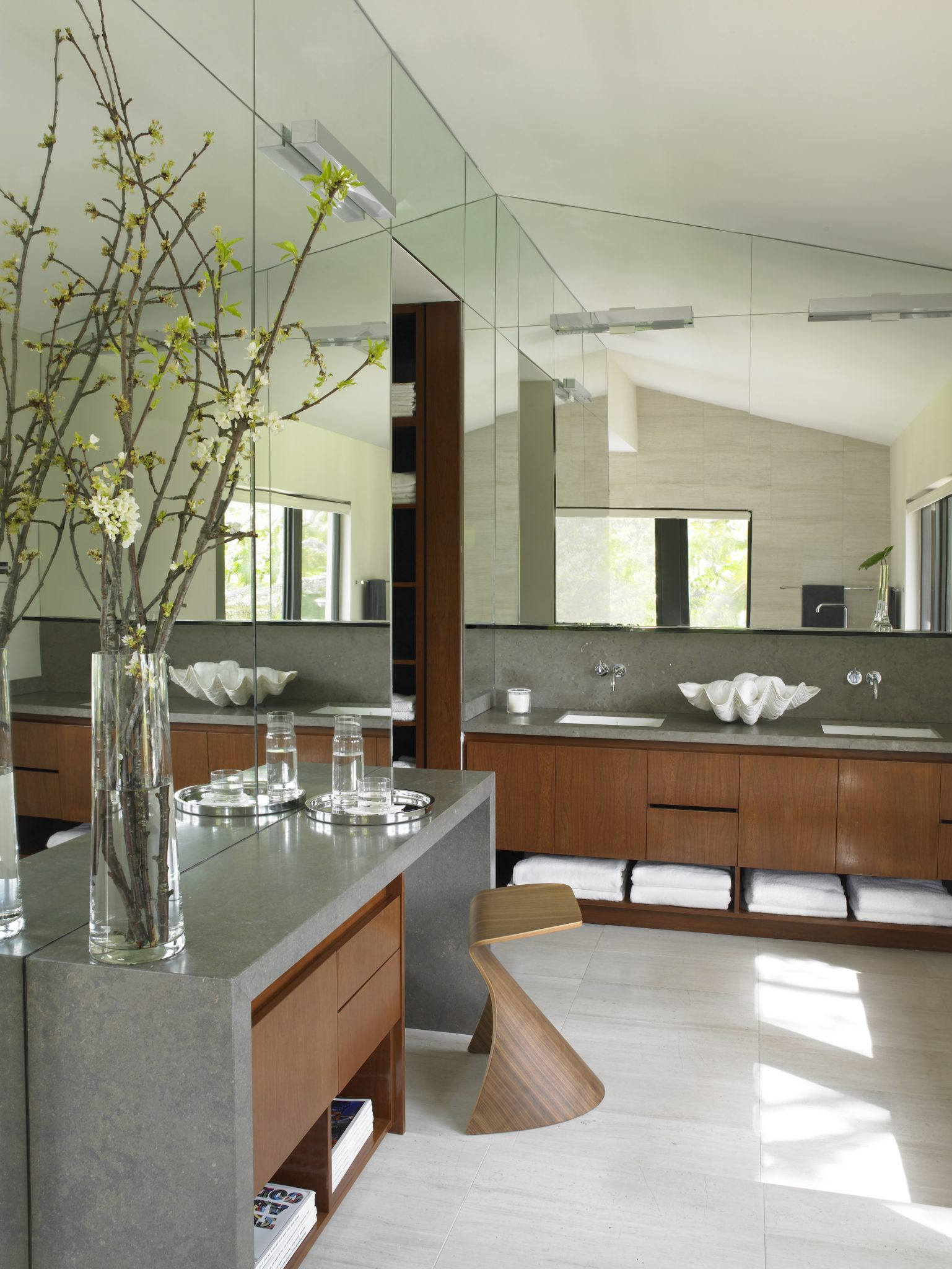 South Florida, mirrored master bath with grey stone countertops - simplicity, warmth, beauty and function. by Michael Wolk Design Associates