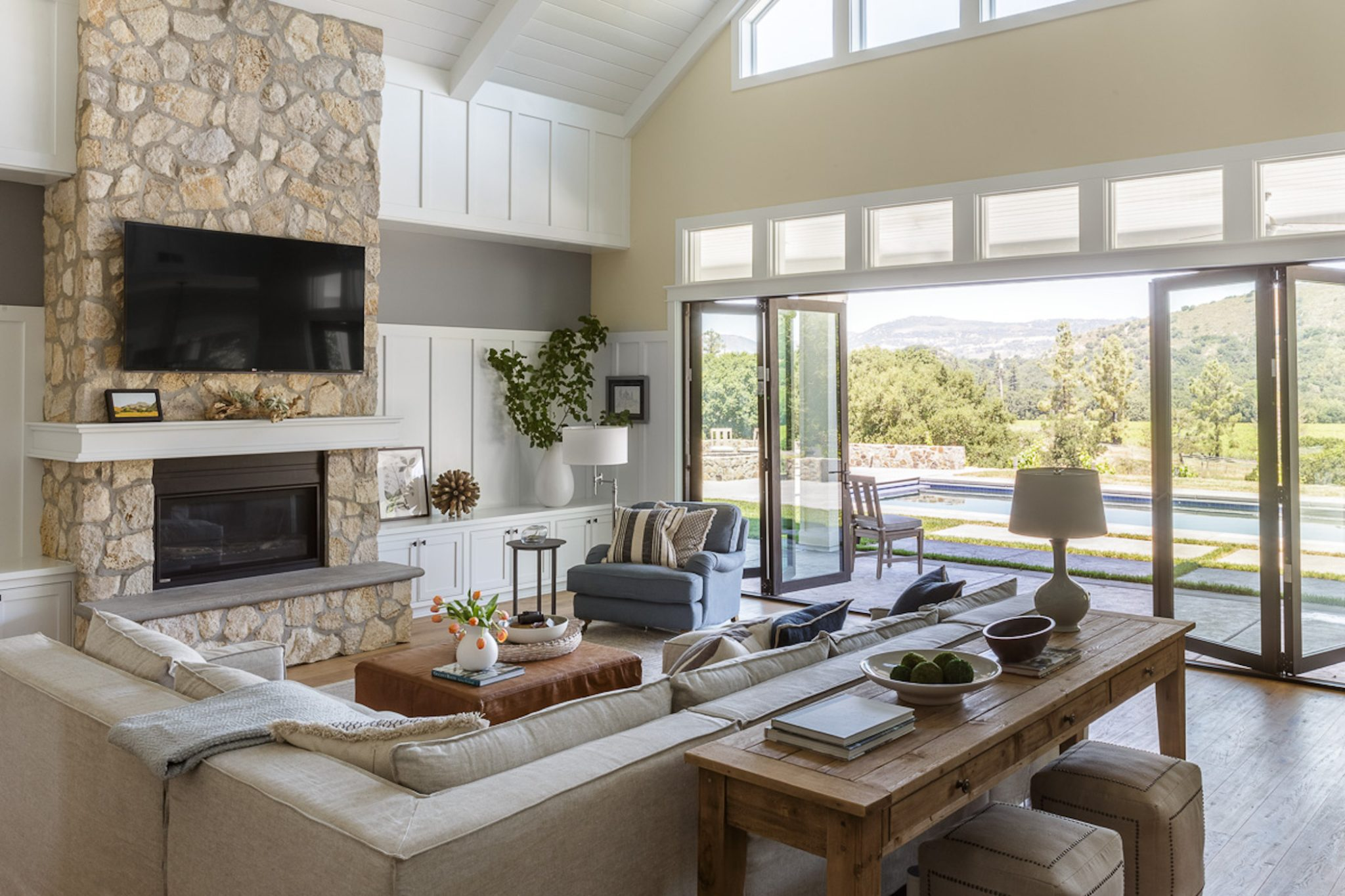 Modern farmhouse on the vineyard knoll with folding doors and stone fireplace by Miyuki Yamaguchi Design Studio