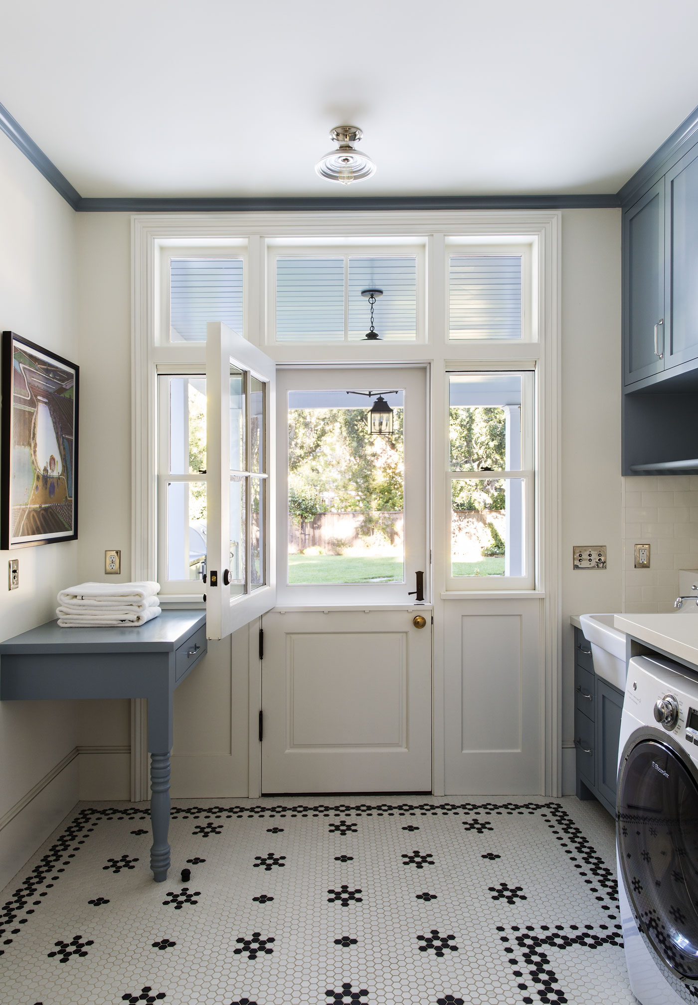 Laundry Room in a New Tennessee-Style Farmhouse by Tim Barber Ltd.