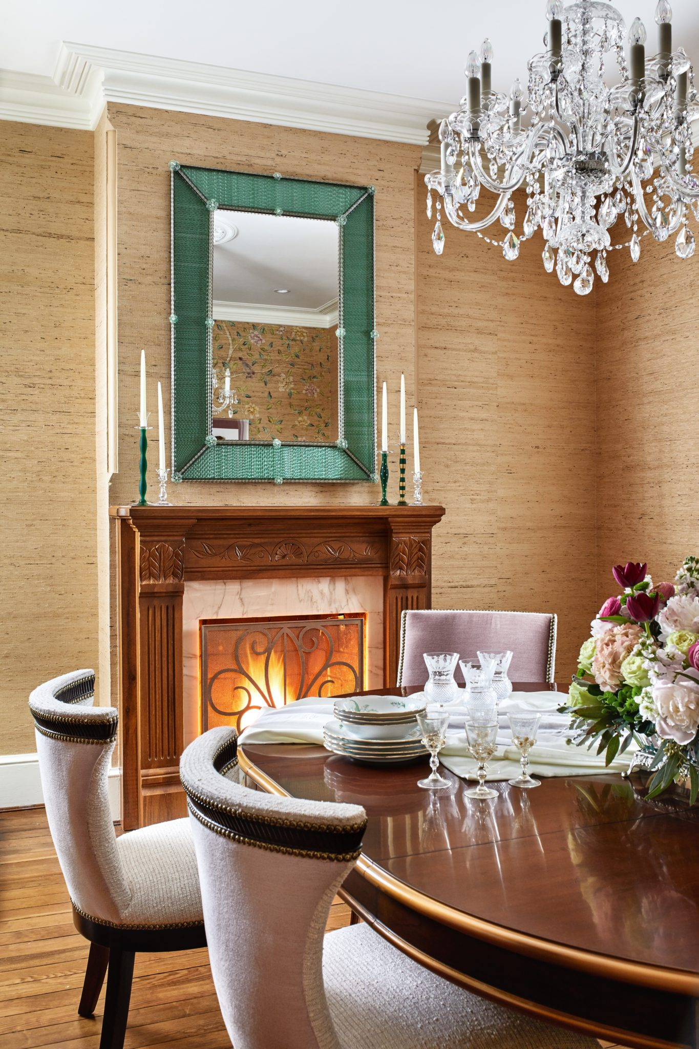Dining room with Murano fireplace mirror, grasscloth walls and crystal lighting by A. Houck Designs