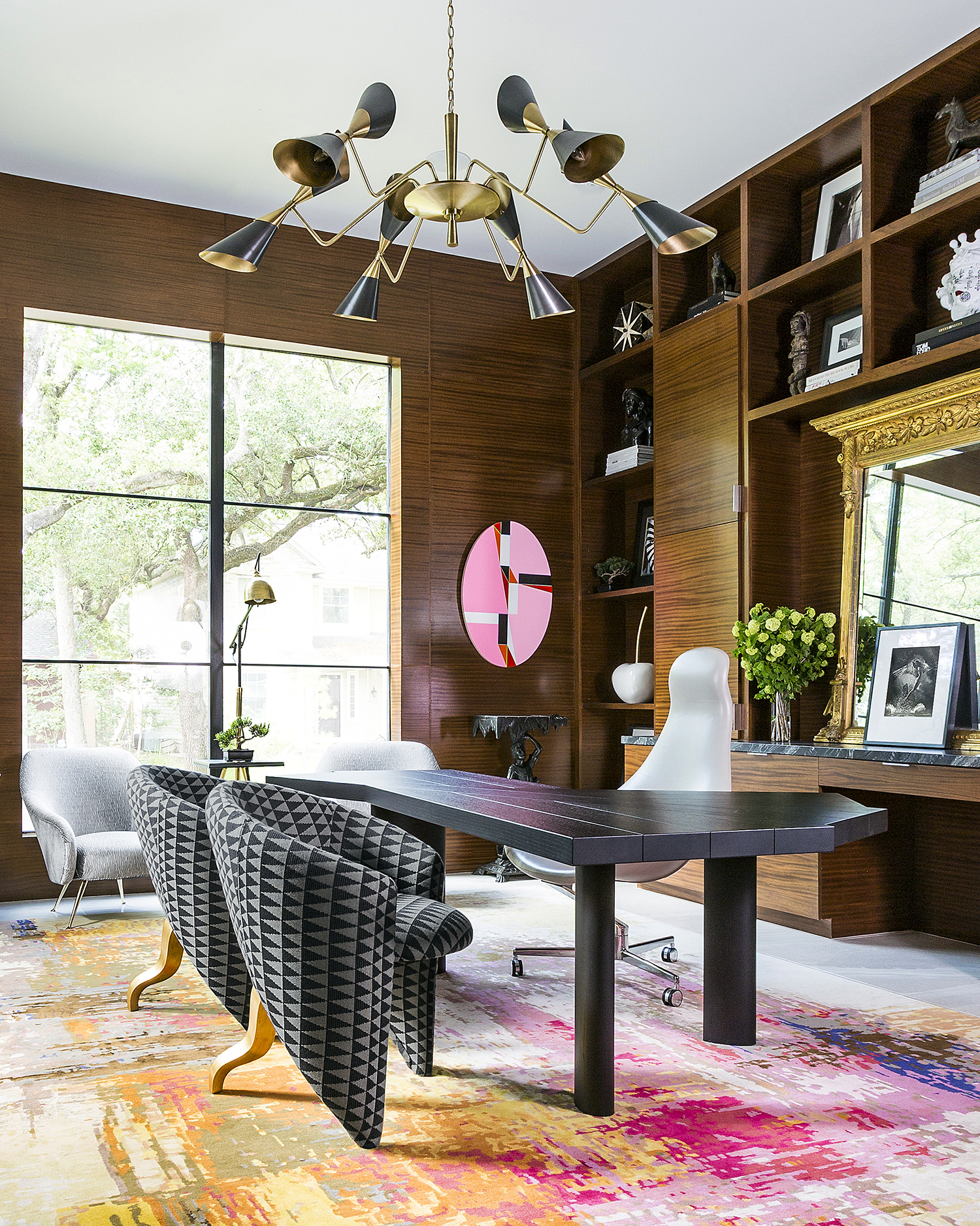 Home office with floor-to-ceiling wood paneling, colorful accents and art by Benjamin Johnston Design