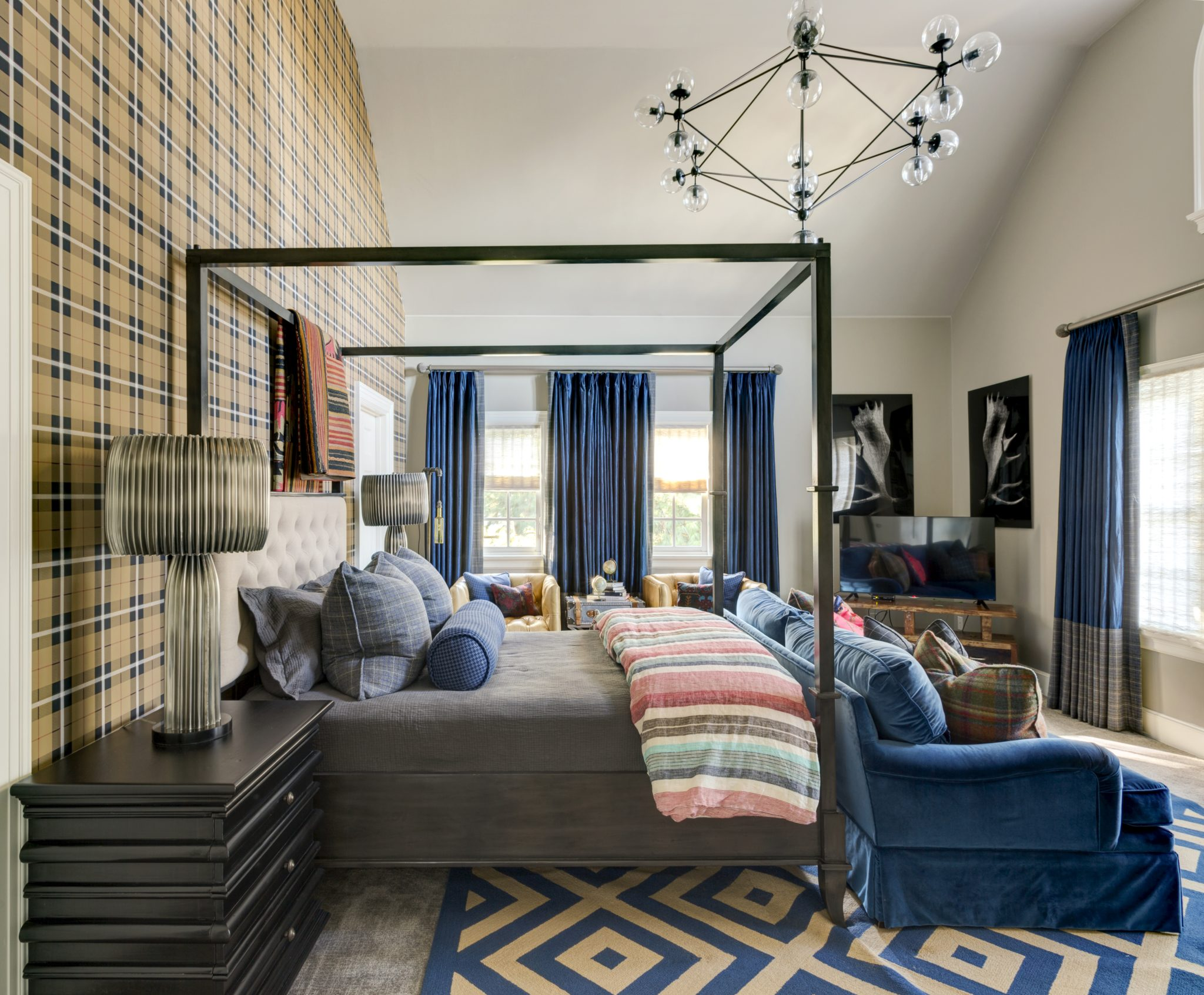 Bedroom highlighted with cobalt blue plaids and tribal textures by Goddard Design Group