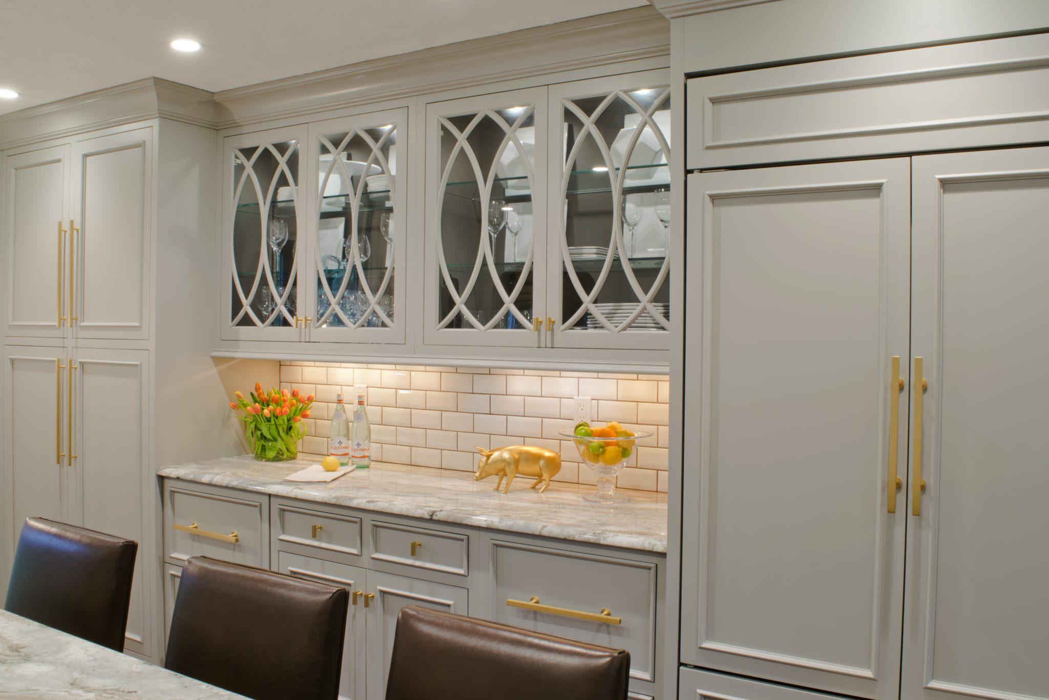 English Tudor kitchen renovation with custom cabinetry andTaj Mahal quartzite by LSM Interior Design