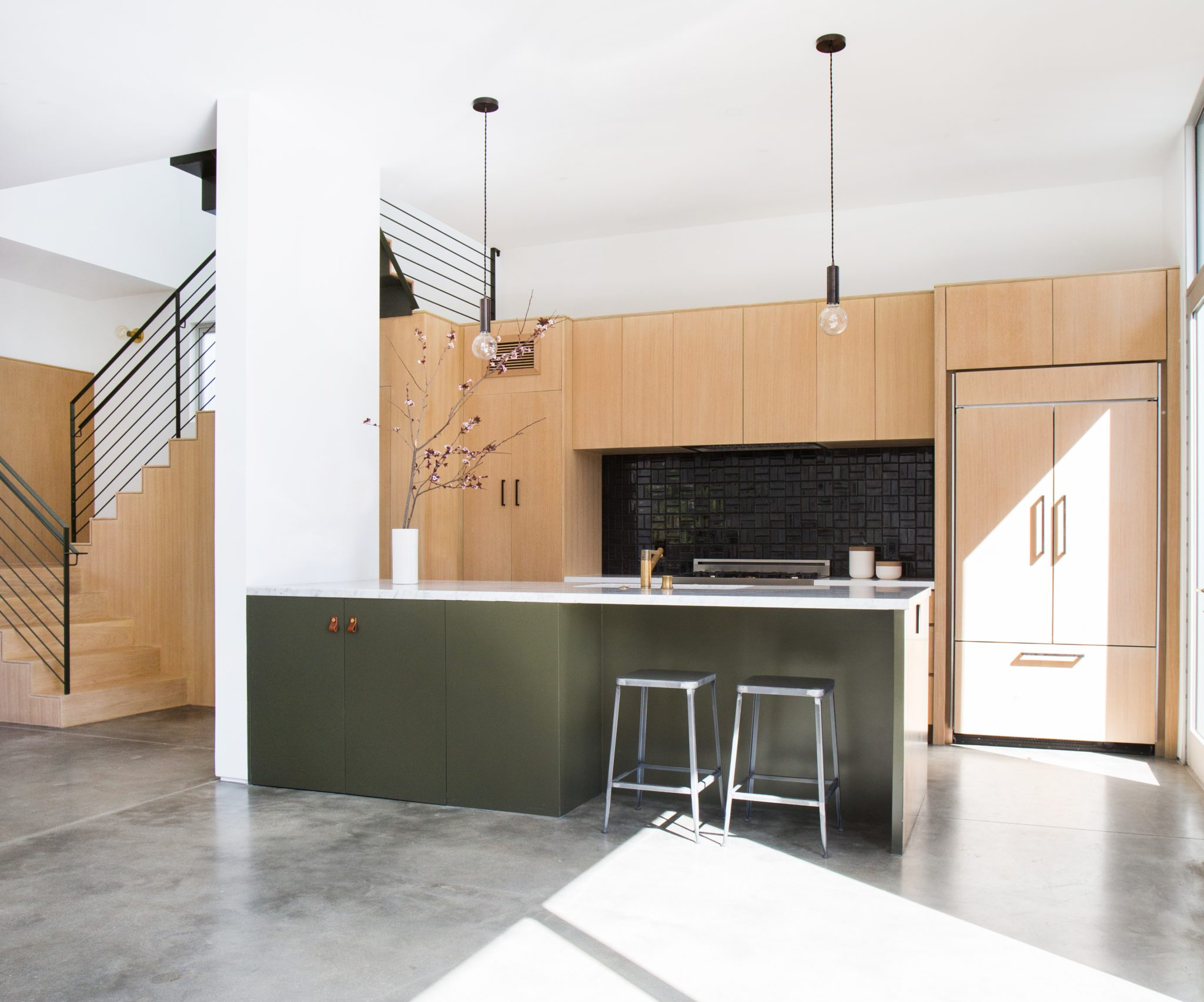 Warm, Modern Open Plan with Concrete Floors and Handmade Ceramic Tile by Stefani Stein Inc.