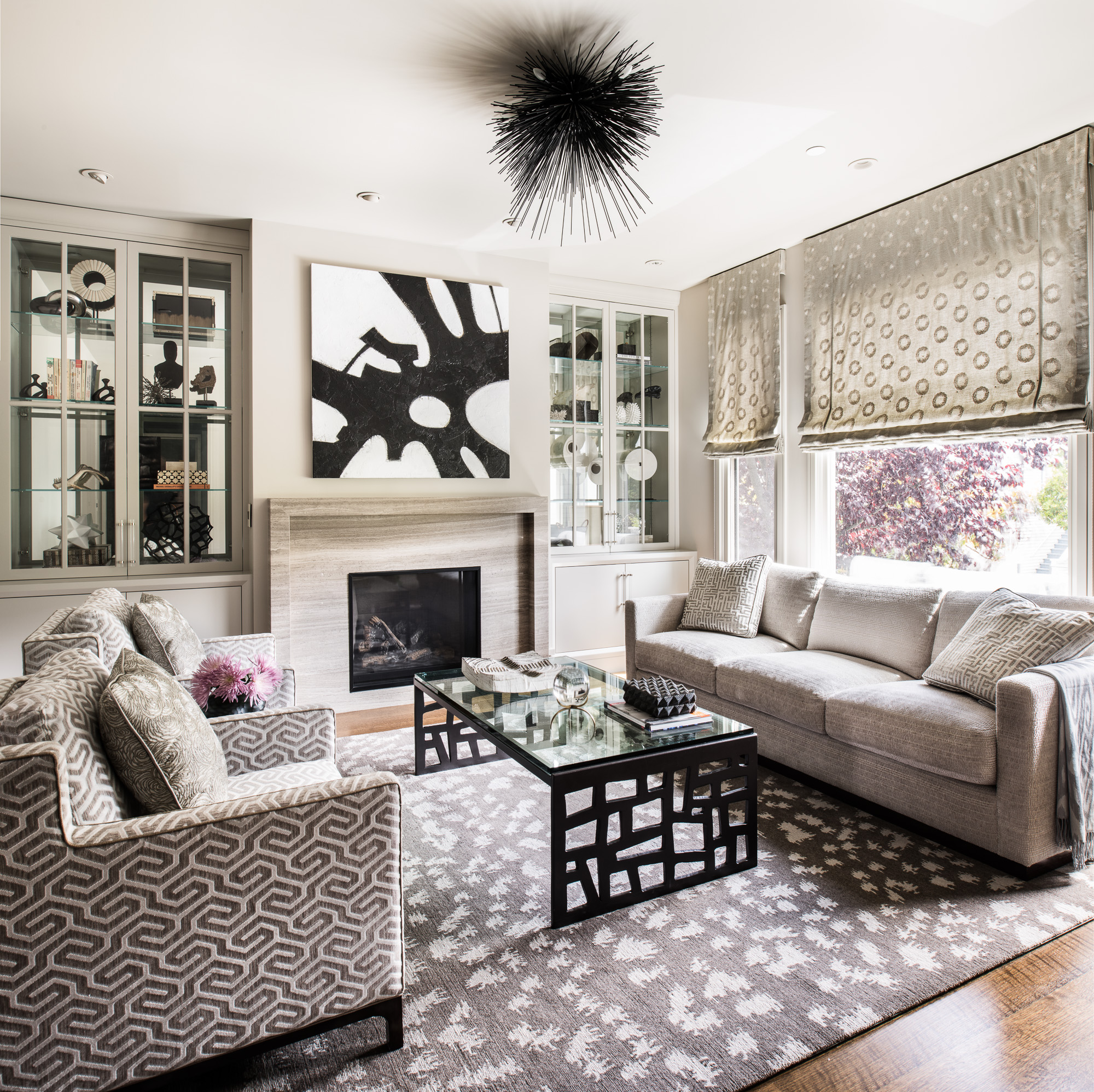 Living room with gray walls, white oak floors, and tonal fabrics with texture accented by bold touches. By Tineke Triggs / Artistic Designs for Living