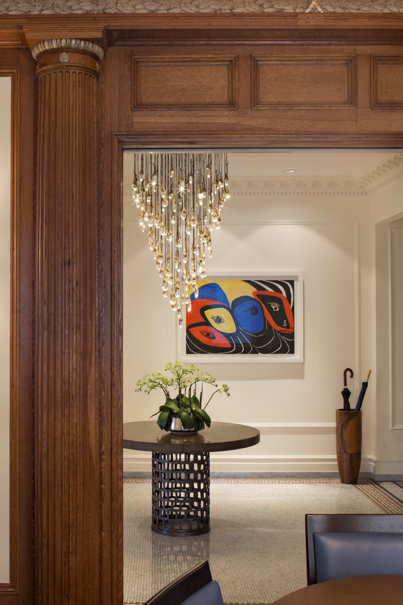 Entrance hall featuring contemporary crystal chandelier by Haver & Skolnick Architects