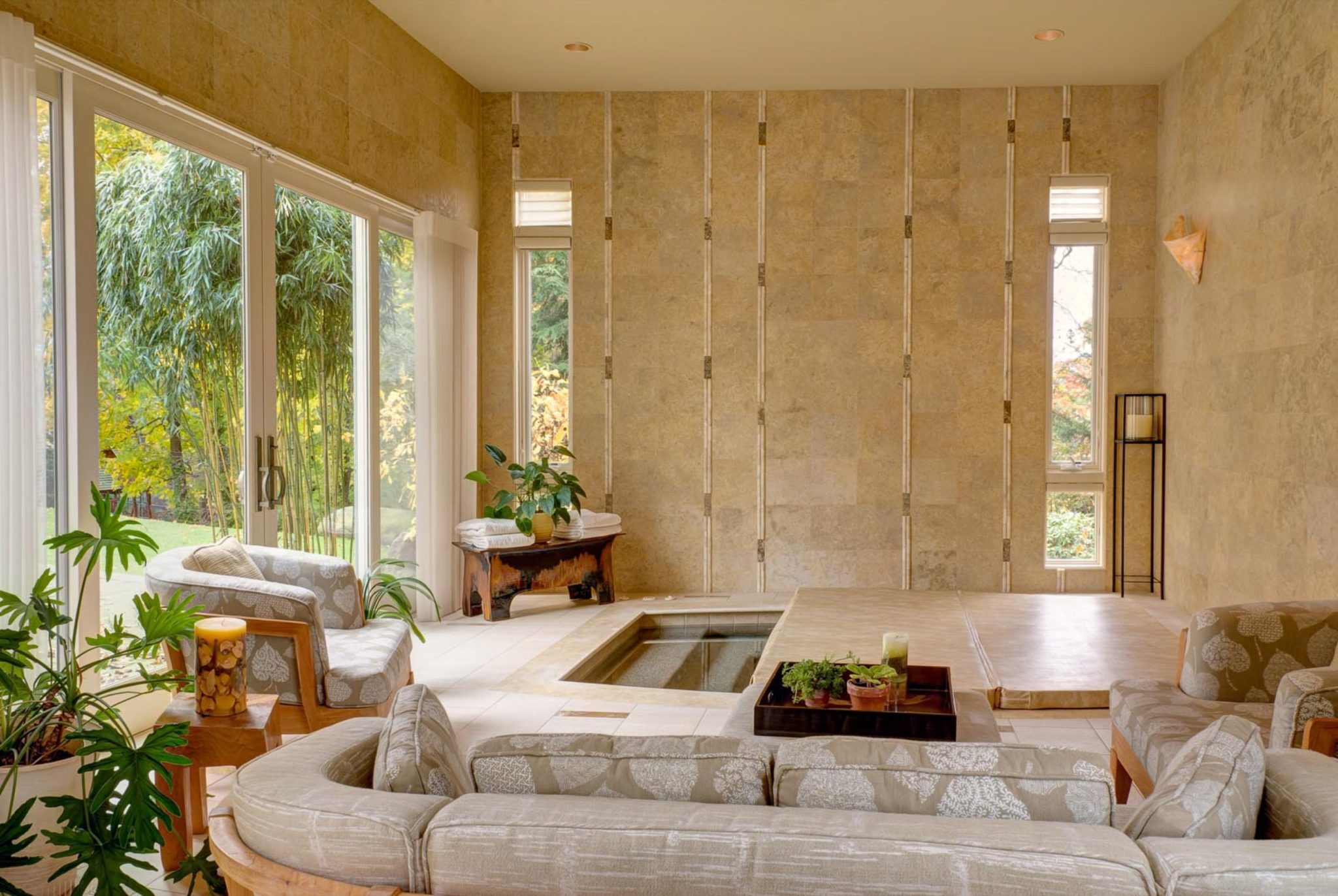 Custom designed stone walls with vertical inset accents of tile and stone by Susan Dearborn Interiors Inc.