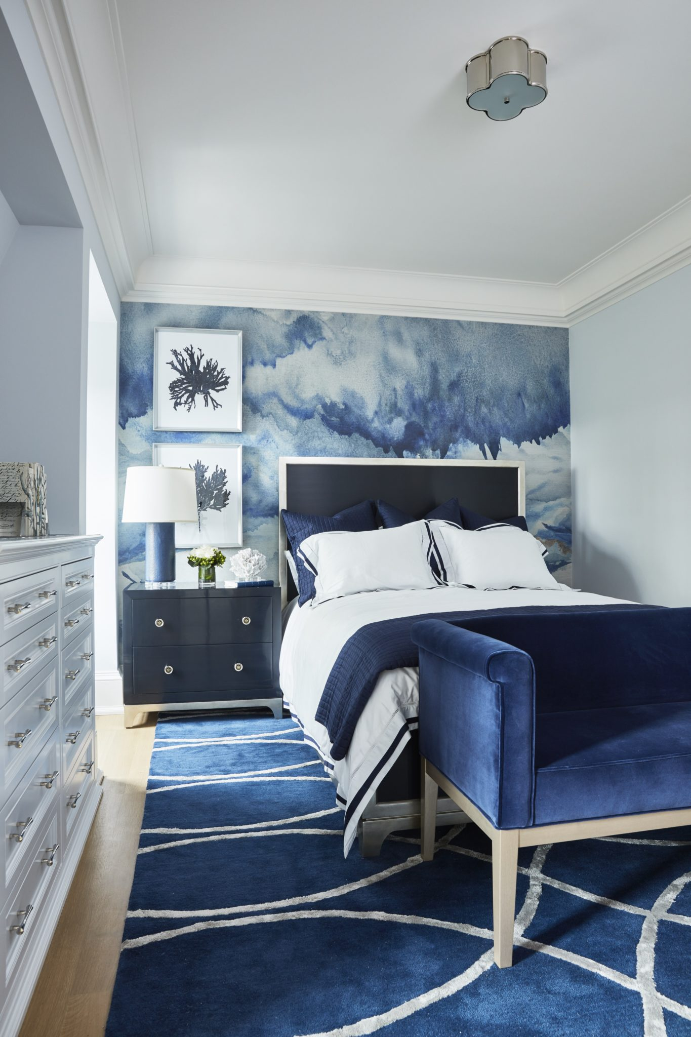 Navy blue bedroom with accent mural wallpaper. by Alexandra Naranjo Designs